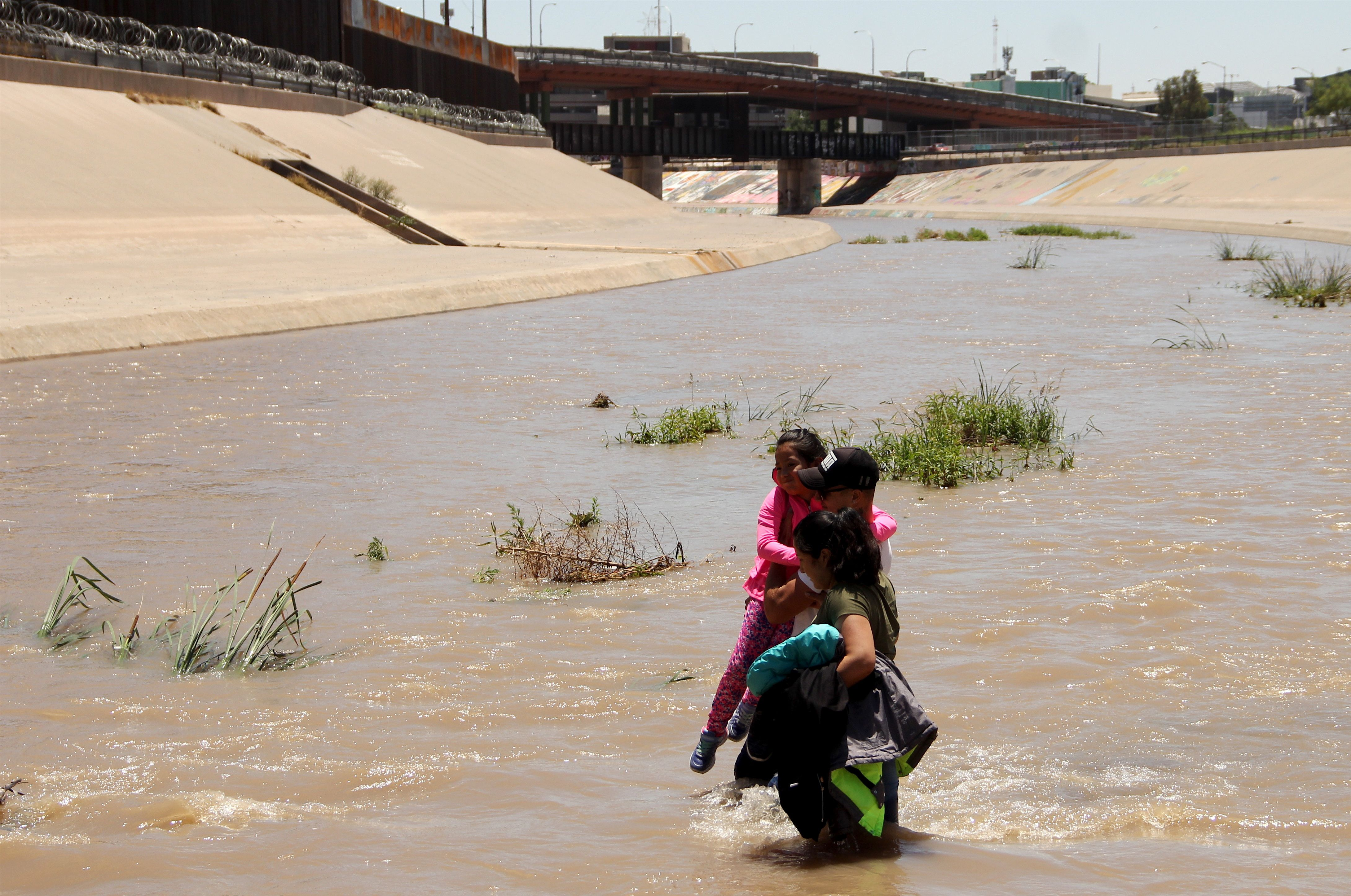 Central American migrants cross the Rio Grande in Ciudad Juarez, on June 12, 2019, before turning themselves into U.S. Border Patrol agents to claim asylum.