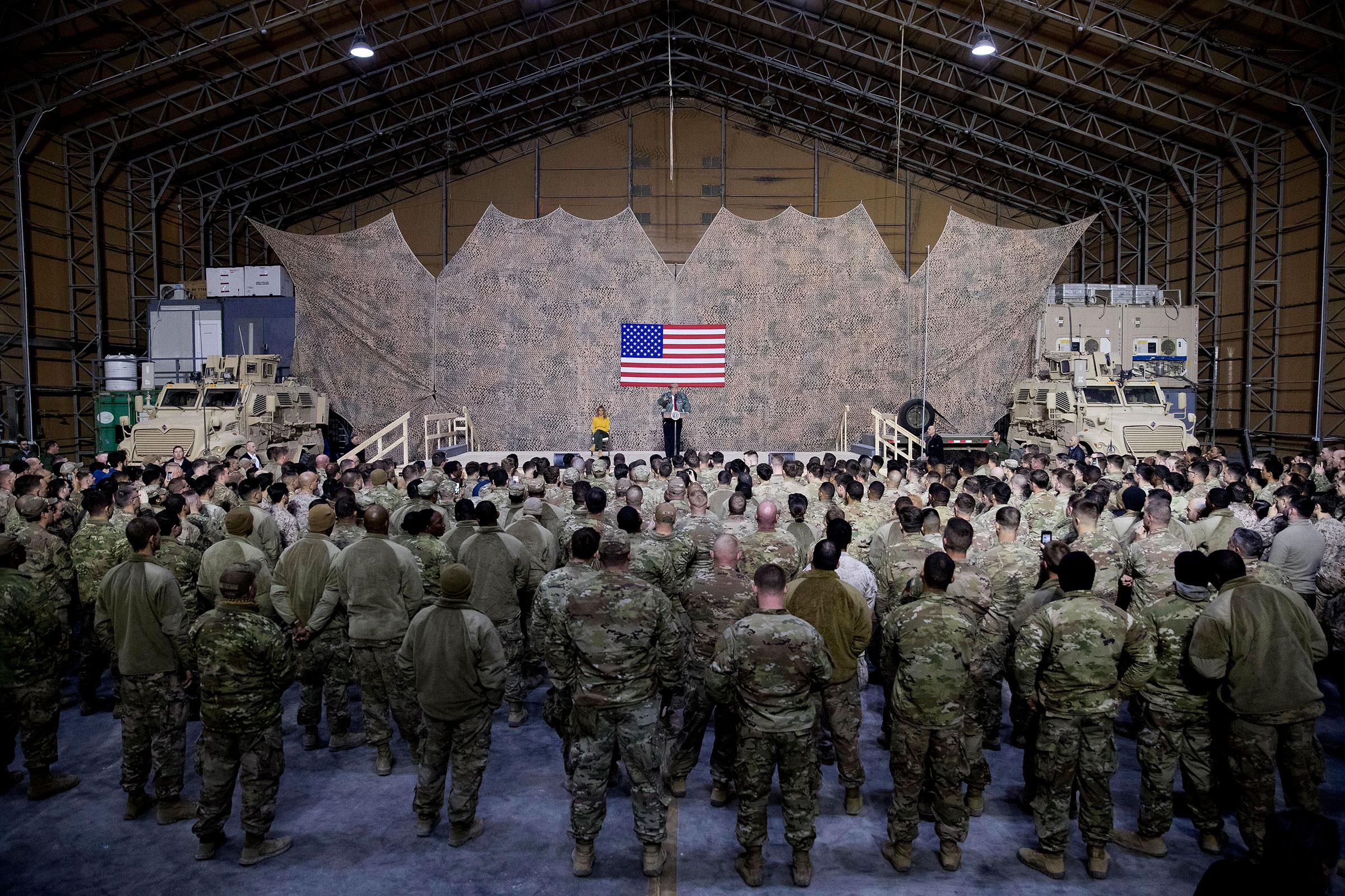 President Trump speaks at a rally in a hangar at Al Asad Air Base, Iraq, on Dec.26, 2018