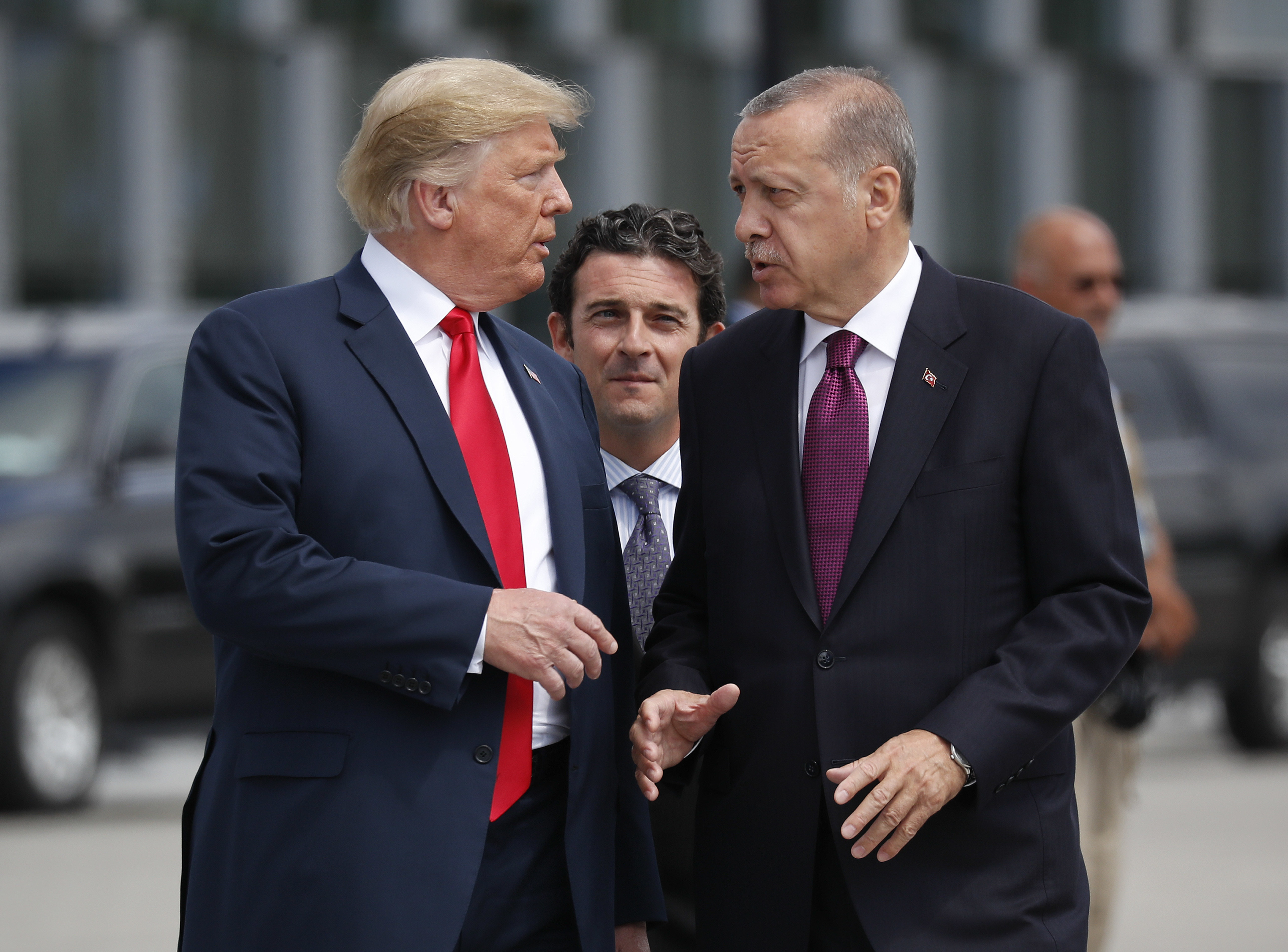 In this Wednesday, July 11, 2018, file photo, President Donald Trump, left, talks with Turkey's President Recep Tayyip Erdogan, as they arrive together for a family photo at a summit of heads of state and government at NATO headquarters in Brussels. The White House says Turkey will soon invade Northern Syria, casting uncertainty on the fate of the Kurdish fighters allied with the U.S. against in a campaign against the Islamic State group.