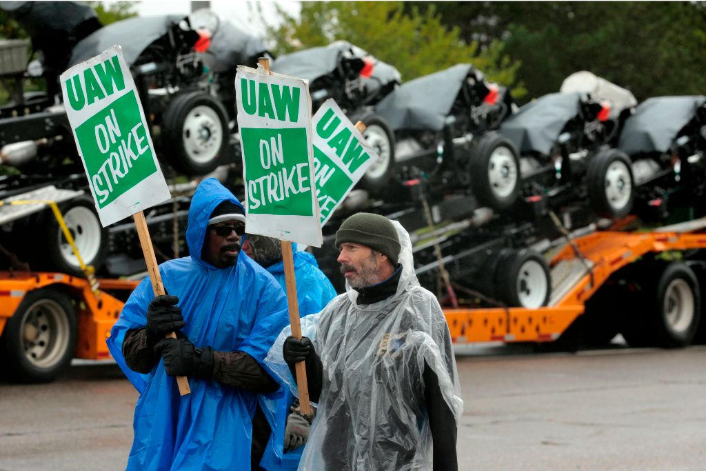United Auto Workers (UAW) members picket outside of General Motors Detroit-Hamtramck Assembly in Detroit, Michigan, as they strike on October 16, 2019.