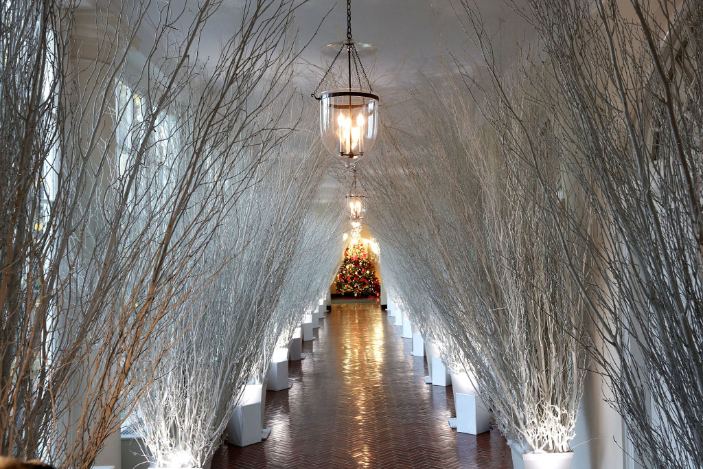 Christmas decorations in a hallway of the East Wing of the White House during a press preview of the 2017 holiday decorations November 27, 2017 in Washington, DC. (Photo by Alex Wong/Getty Images)