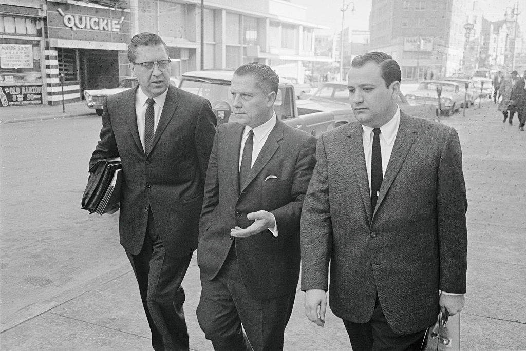 Jimmy Hoffa (center) with his attorney William Bufalino (left) and an aide, leaving federal court after Hoffa was convicted of jury tampering