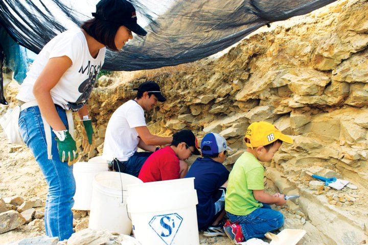 Family at dig site of Wyoming Dinosaur Center.