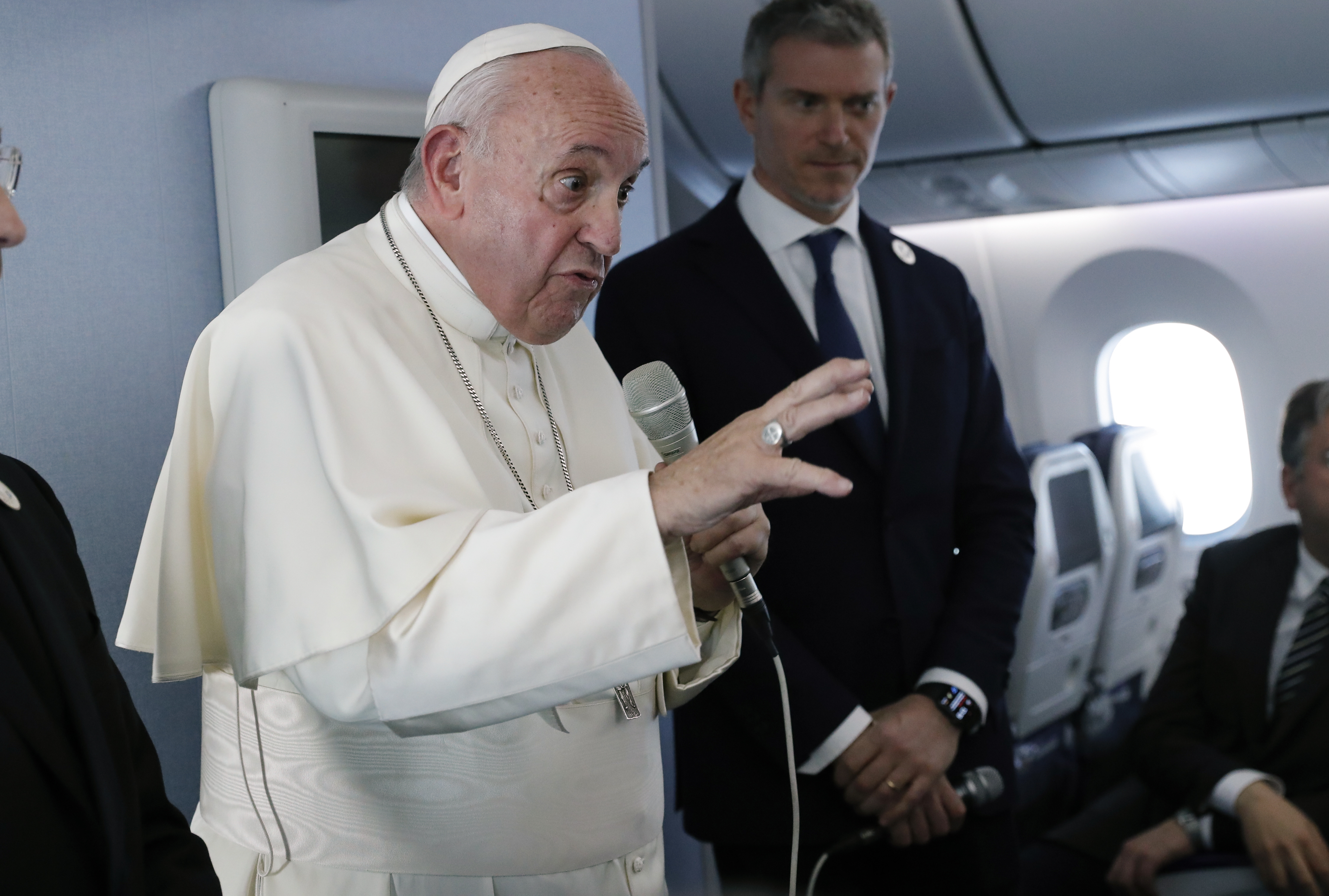 Pope Francis speaks during a news conference onboard the papal plane on his flight back from a trip to Thailand and Japan, Monday, Nov. 26, 2019.