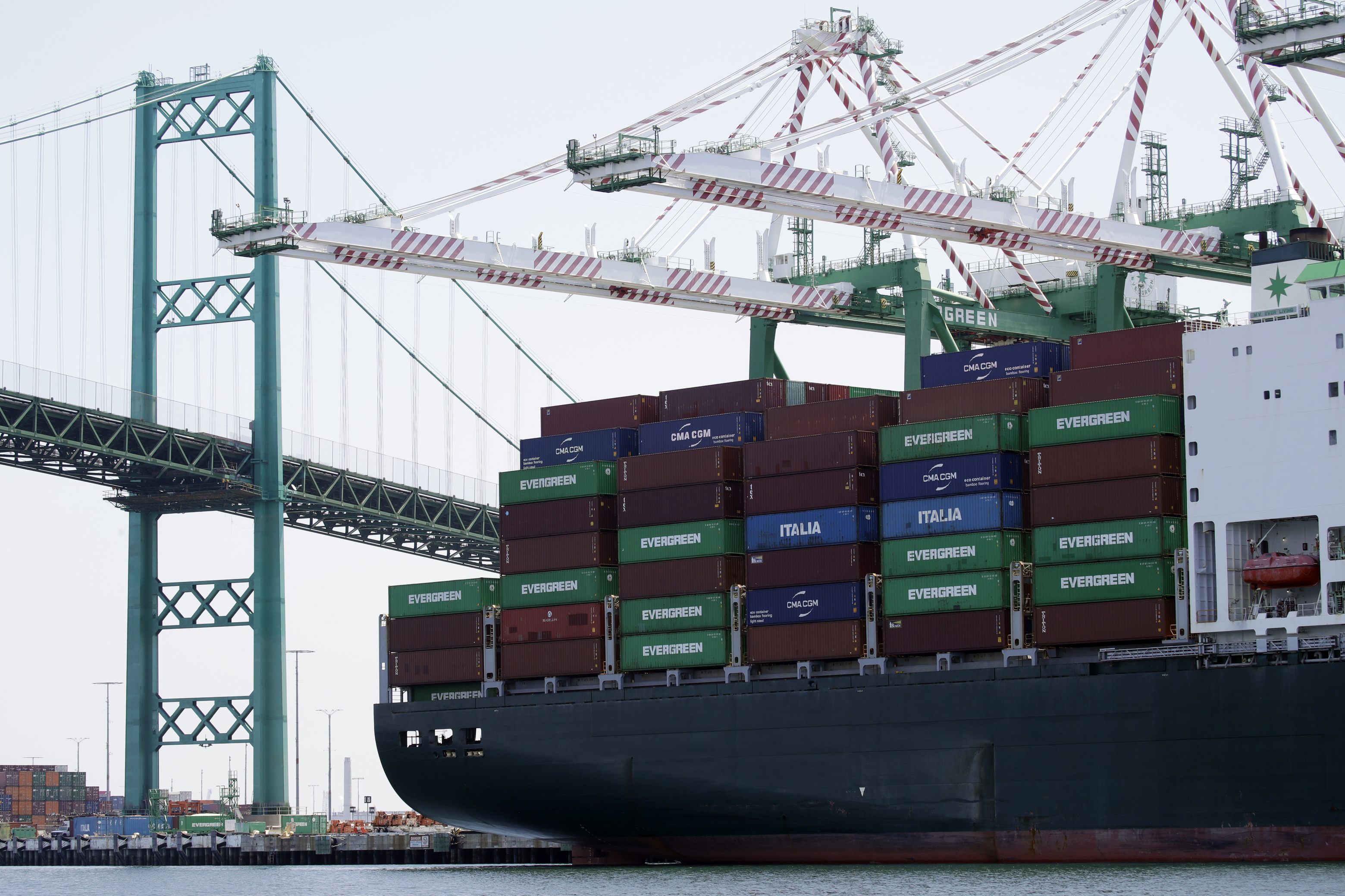 In this June 19, 2019, file photo a cargo ship is docked at the Port of Los Angeles