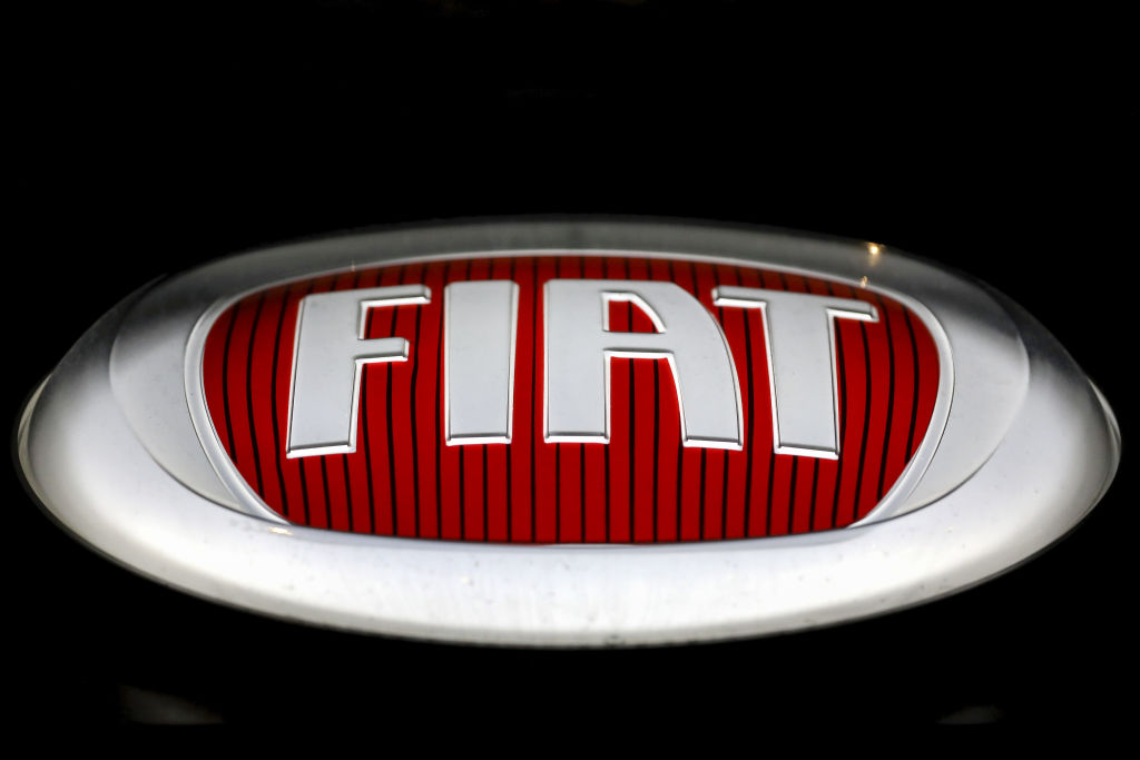 The Fiat Chrysler Automobiles NV (FCA) logo sits on the outside wall of one of the company's car dealerships in Rome, Italy, on Thursday, Oct. 31, 2019.