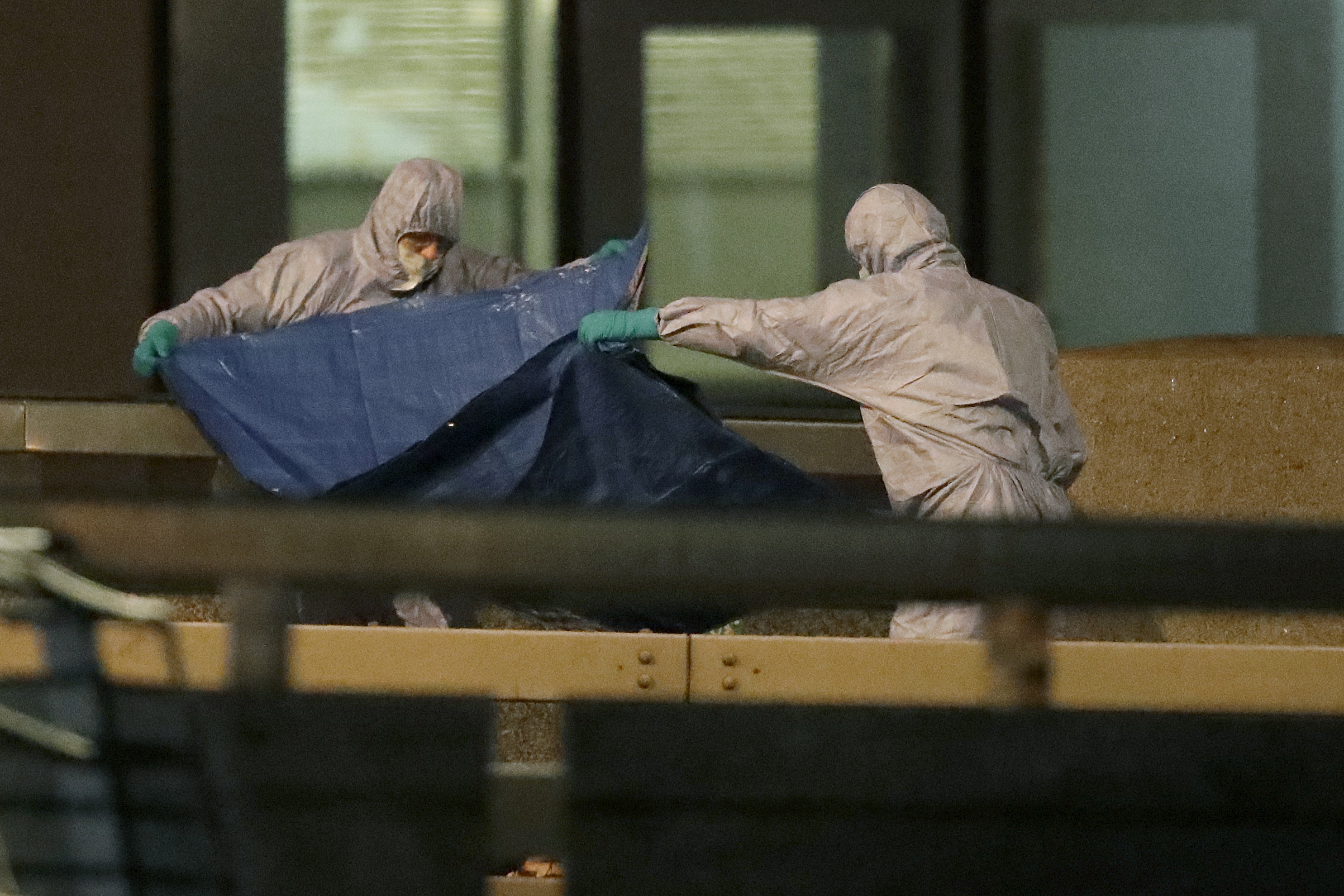Police forensic officers work where a man was killed on London Bridge following an incident in London, Friday, Nov. 29, 2019.