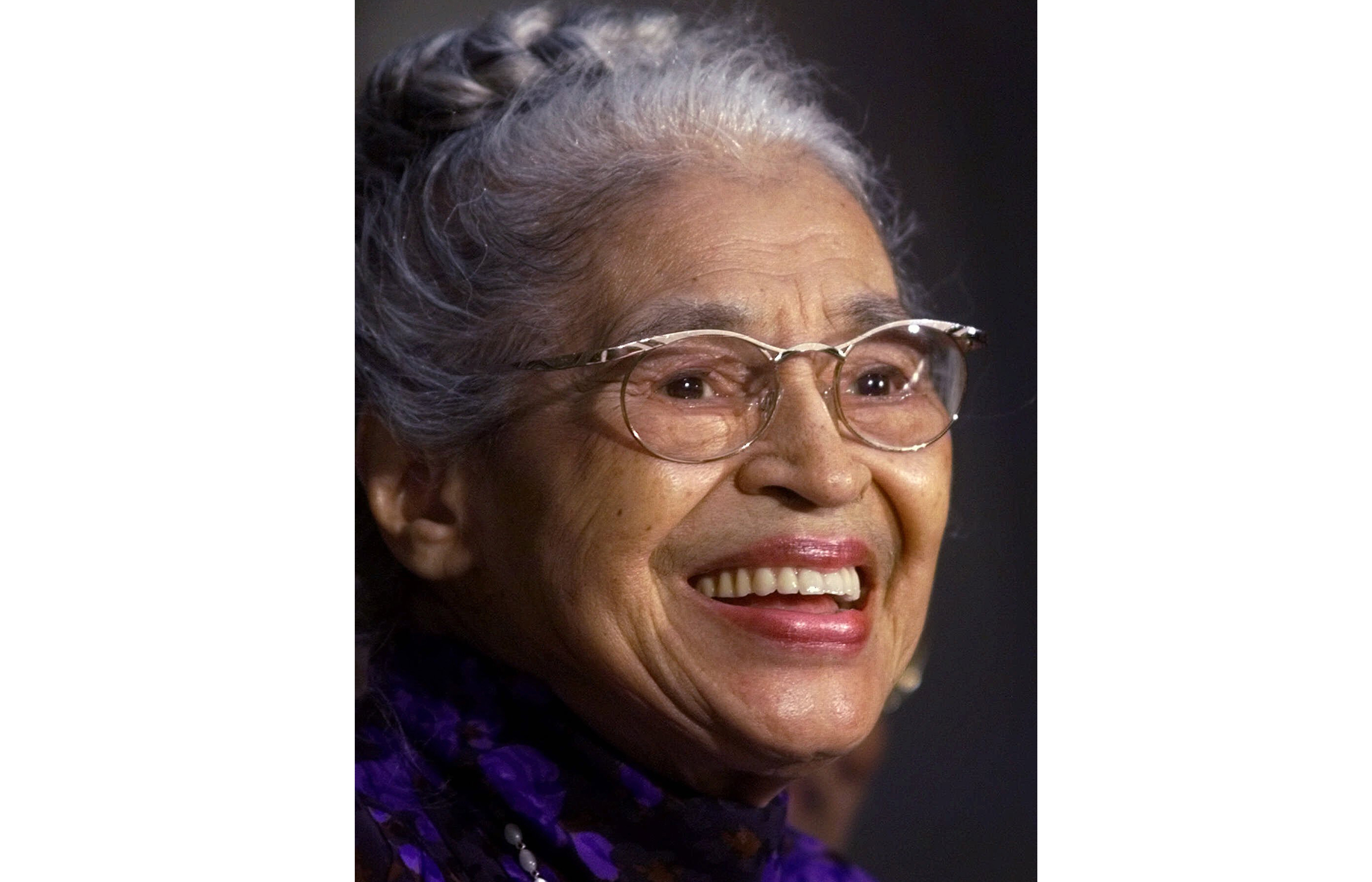 Rosa Parks smiles during a Capitol Hill ceremony where Parks was honored with the Congressional Gold Medal in Washington, D.C., on June 15, 1999.