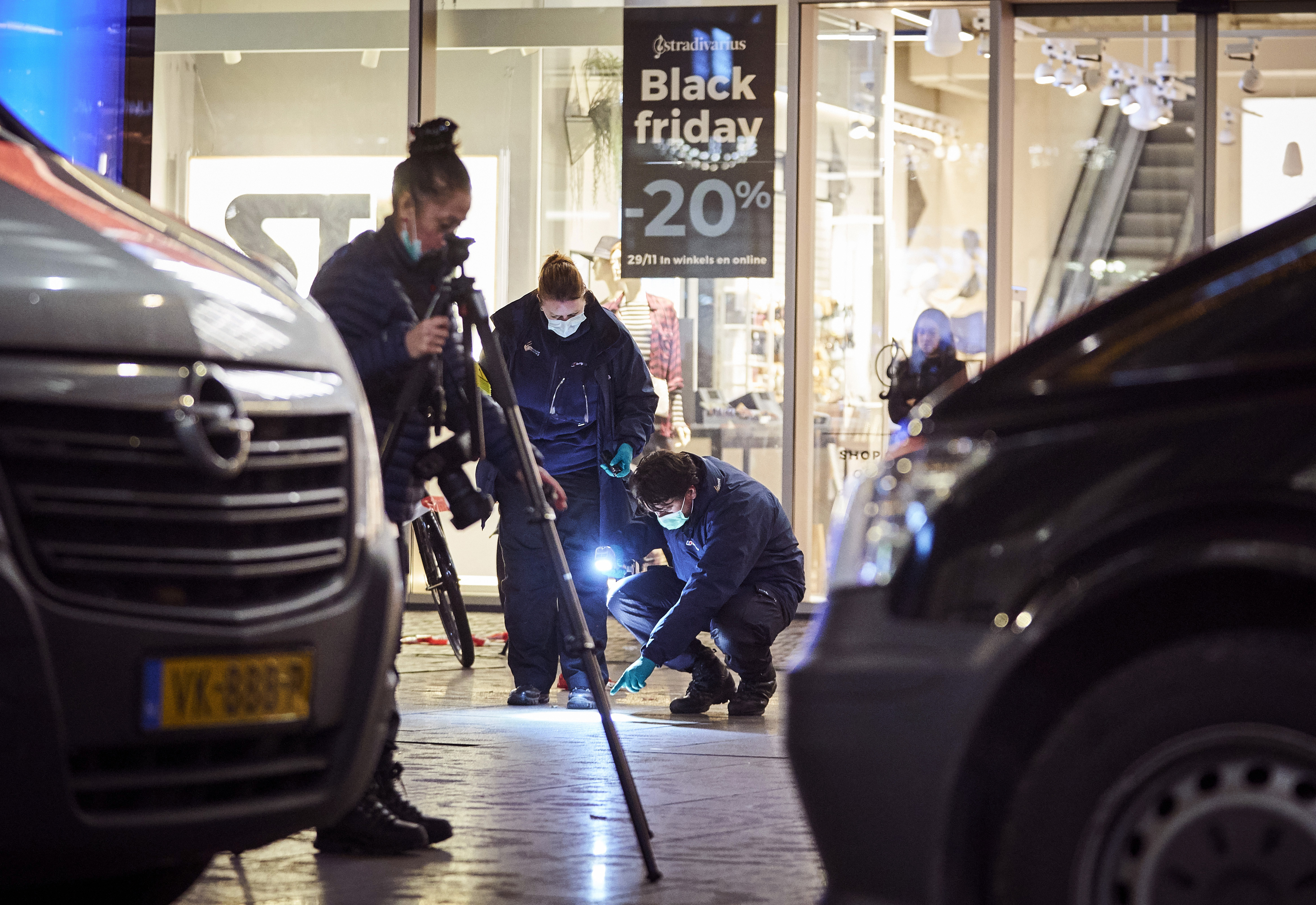 Forensic experts look for clues on the scene of a stabbing incident in the center of The Hague, Netherlands, Friday, Nov. 29, 2019.