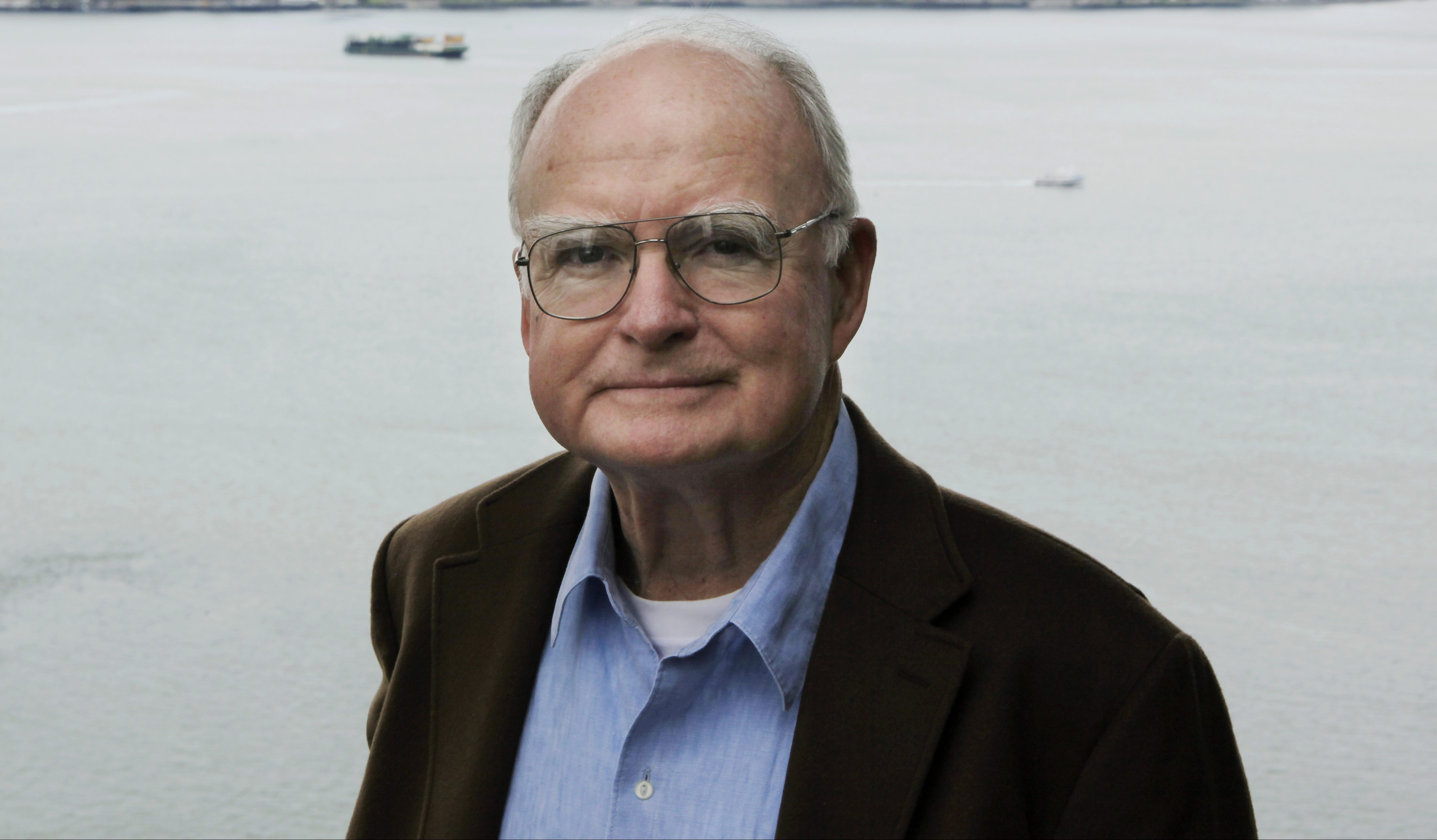 In this April 13, 2009, photo, William Ruckelshaus poses for photos at his office in Seattle.