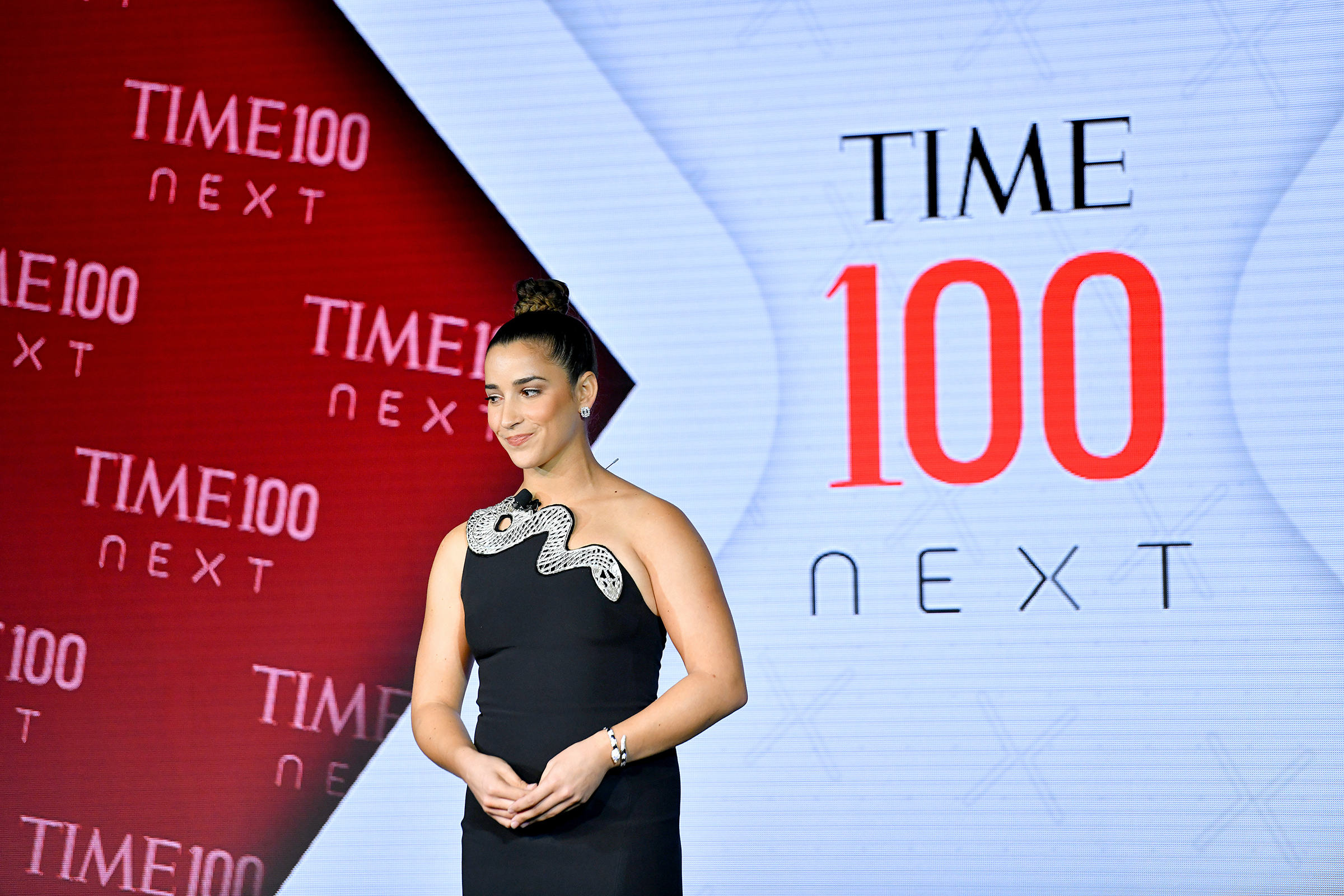Aly Raisman speaks onstage during TIME 100 Next 2019 at Pier 17 in New York on Nov. 14, 2019.