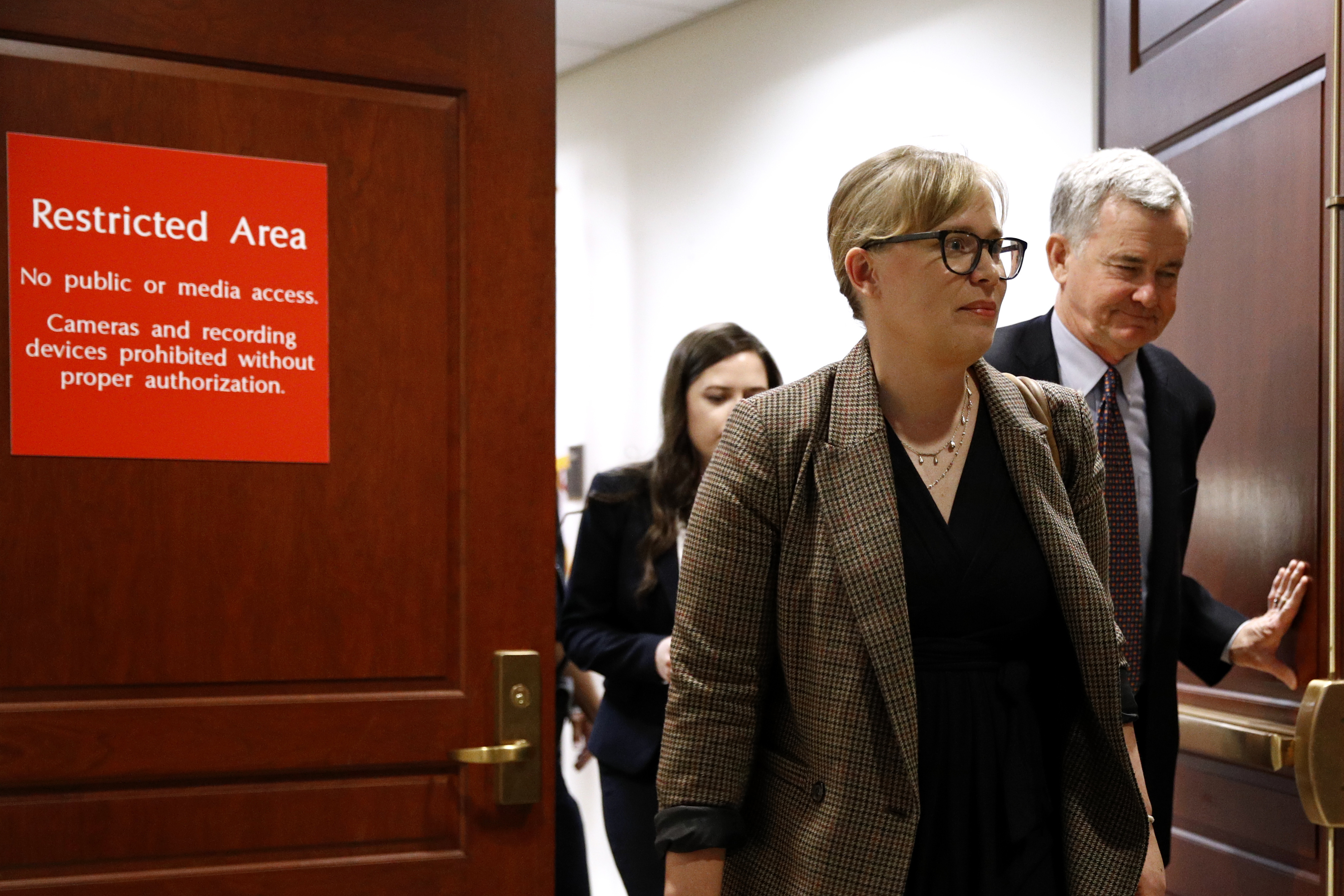 Catherine Croft, a State Department adviser on Ukraine, departs a secure area of the Capitol after a closed door meeting where she testified as part of the House impeachment inquiry into President Donald Trump, Wednesday, Oct. 30, 2019, on Capitol Hill in Washington.