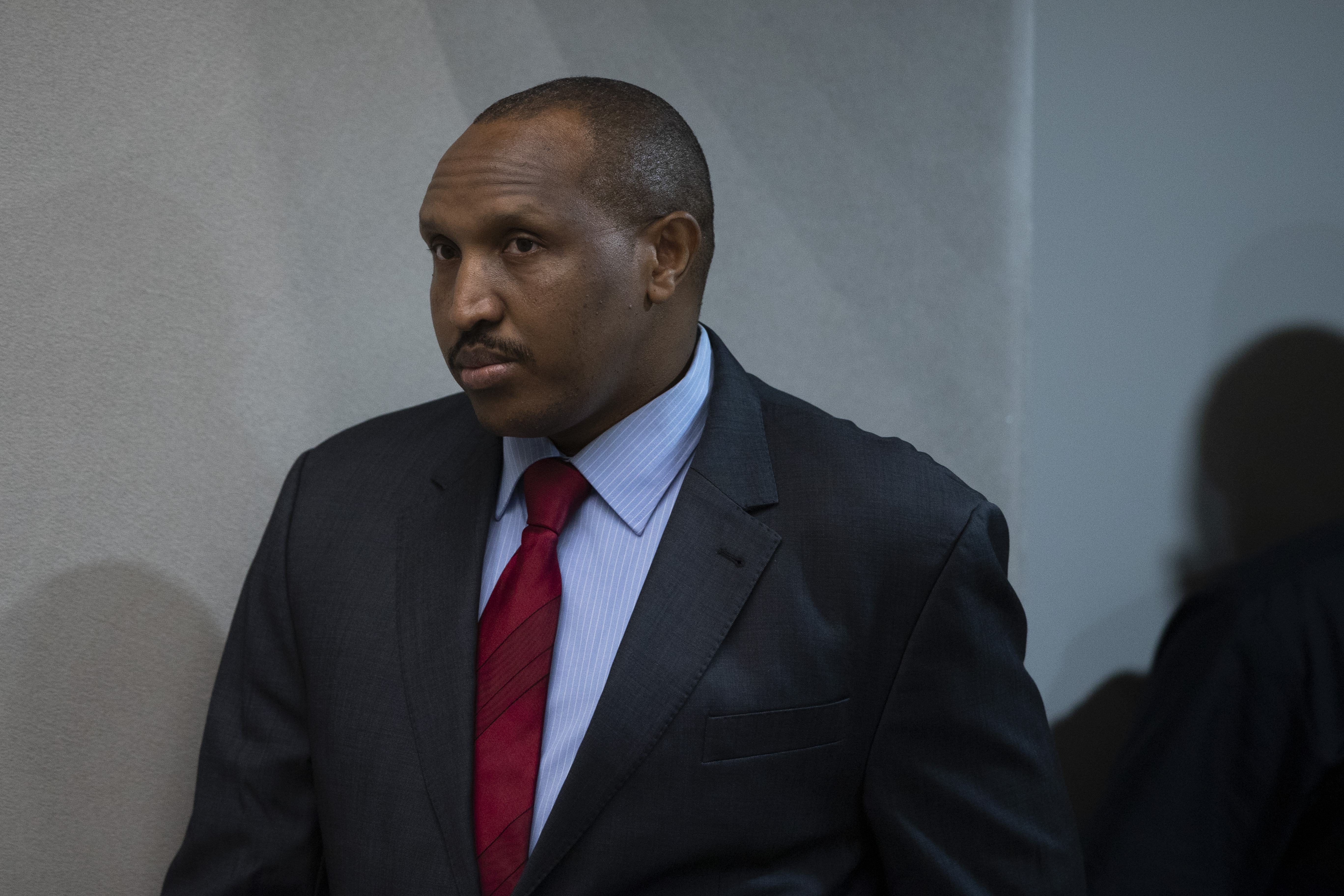 Congolese militia commander Bosco Ntaganda enters the courtroom of the International Criminal Court, or ICC, to hear the sentence in his trial in The Hague, Netherlands, Thursday, Nov. 7, 2019.