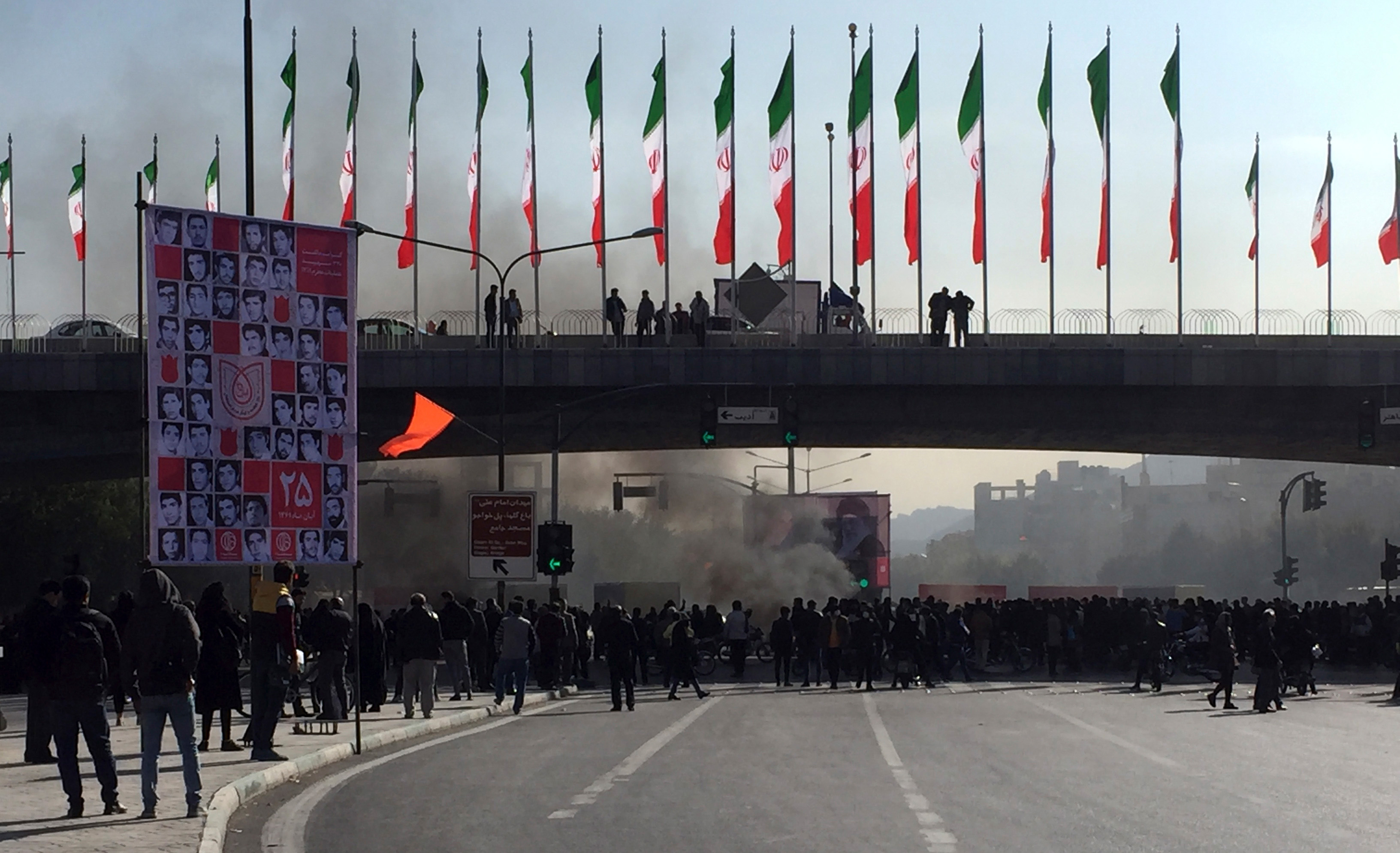 Smoke rises during a protest after authorities raised gasoline prices, in the central city of Isfahan, Iran, Saturday, Nov. 16, 2019.