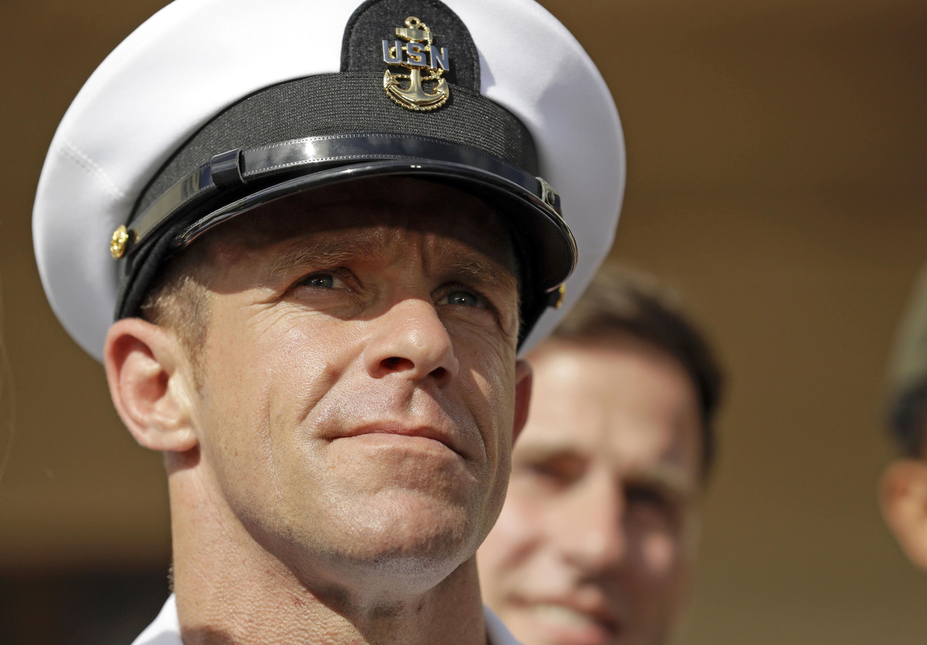 In this Tuesday, July 2, 2019, file photo, Navy Special Operations Chief Edward Gallagher leaves a military court on Naval Base San Diego. The attorney for Gallagher, convicted of posing with a dead captive in Iraq, says the Navy is trying to remove the special operations chief from the elite fighting force in retaliation for President Donald Trump restoring his rank. Defense attorney Timothy Parlatore said the Navy is holding a review board proceeding to remove Edward Gallagher's Trident pin and summoned him to meet with the SEAL leadership on Wednesday, Nov. 20, 2019.