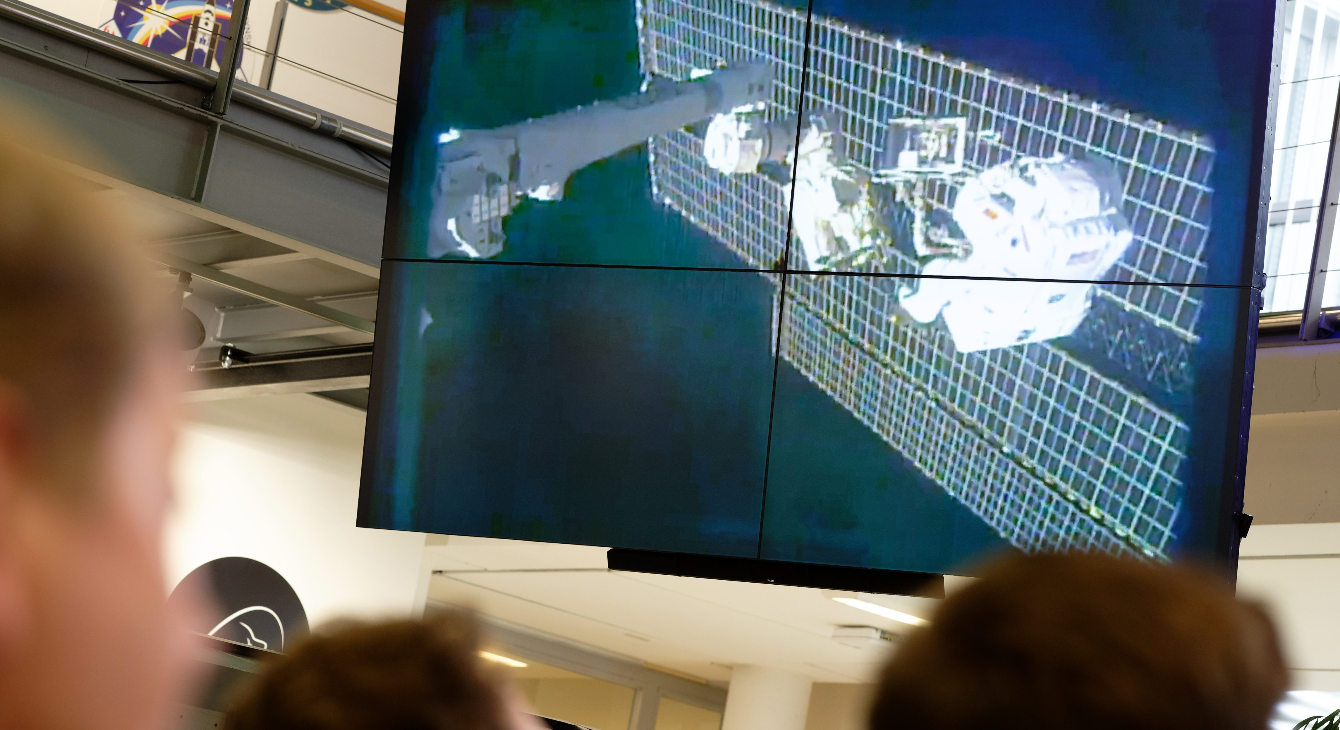 ESA astronaut Luca Parmitano seen floating on a robotic arm above the ISS space station in a video feed at an event at the European Astronaut Centre on Nov. 15, 2019.