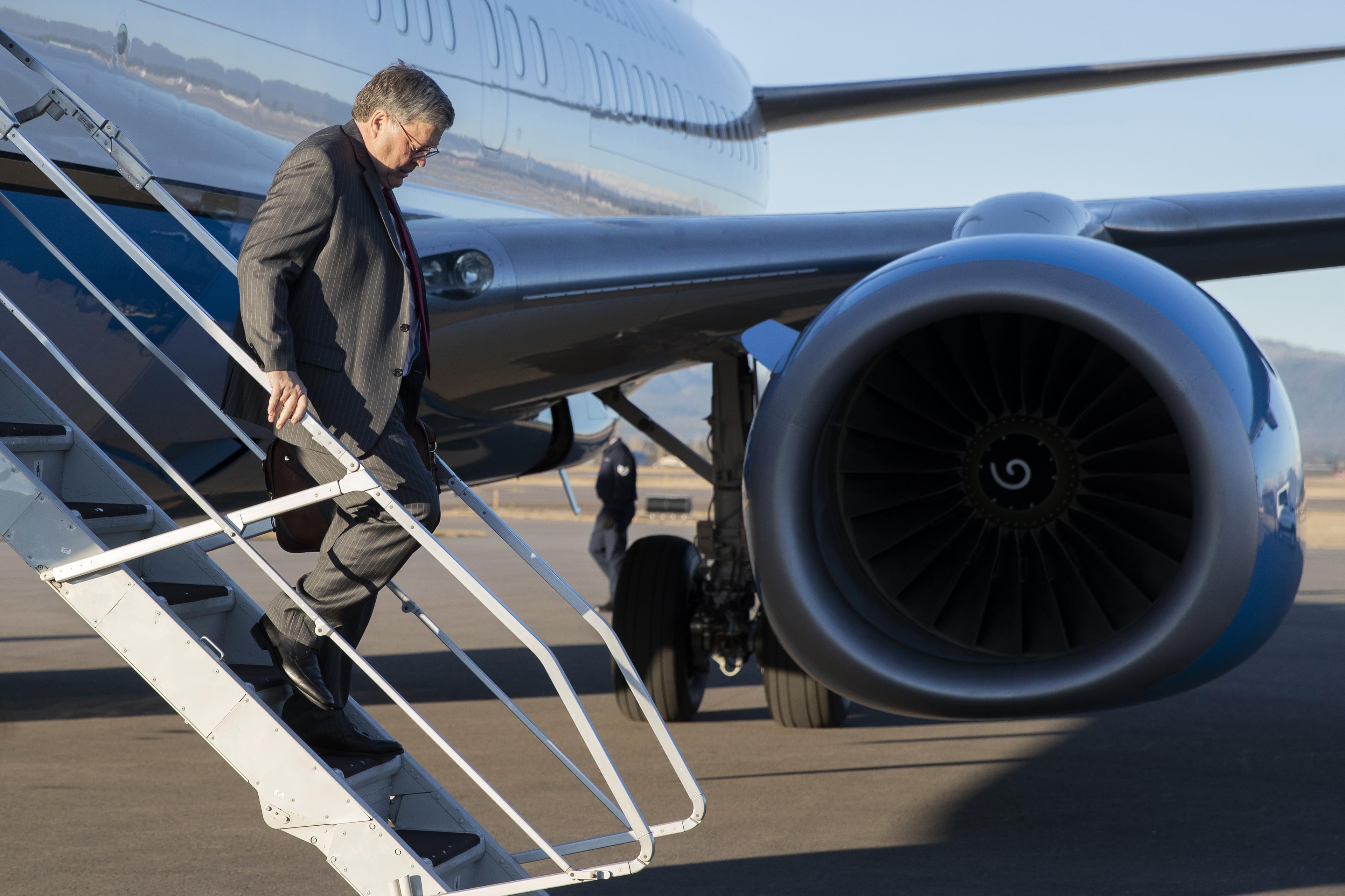Attorney General William Barr steps off an aircraft at Glacier Park International Airport, Thursday, Nov. 21, 2019, in Kalispell, Mont.
