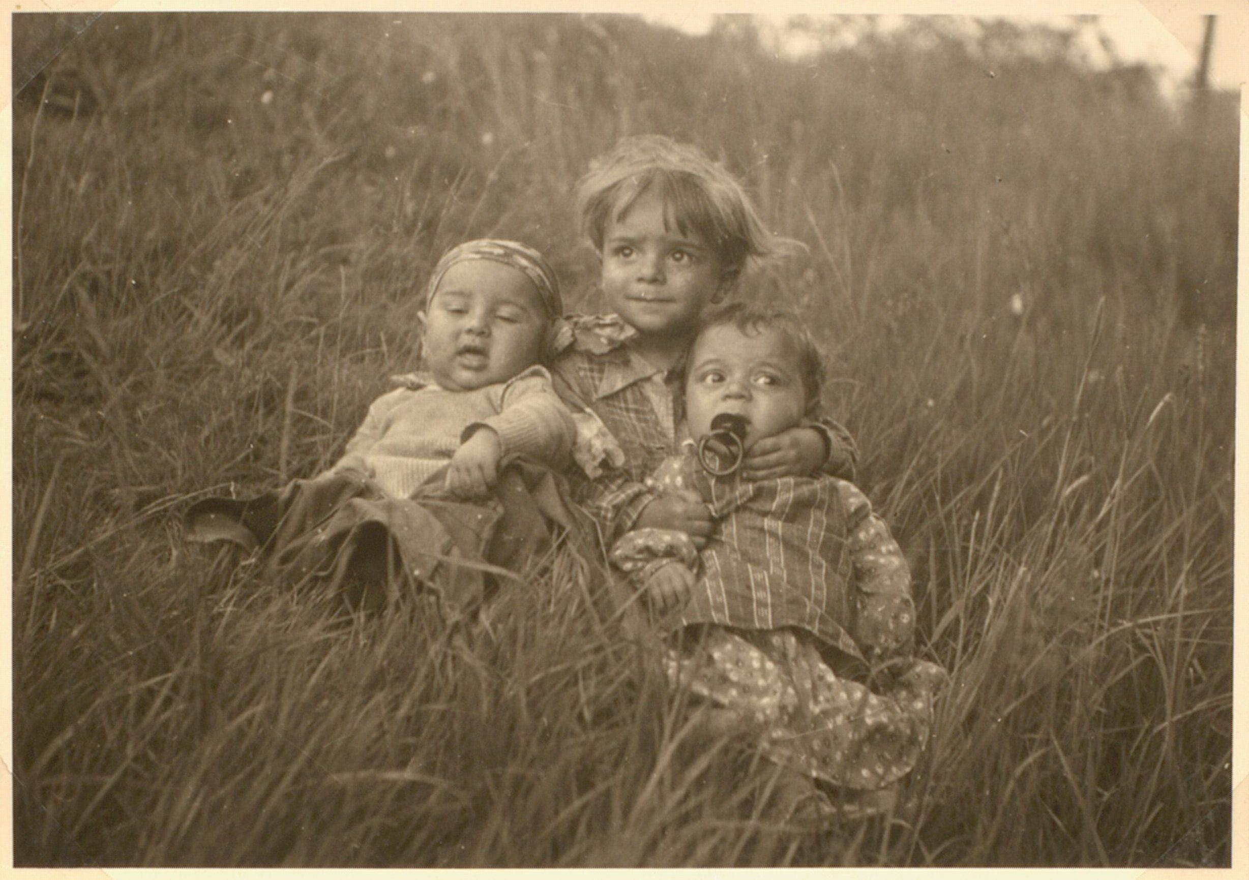 August, a Sinti boy (center), and relatives in Germany. August died in Auschwitz concentration camp, as almost certainly did the other children.