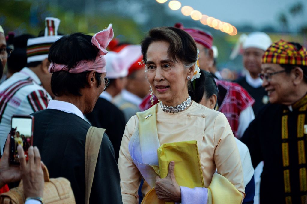 Myanmar State Counsellor Aung San Suu Kyi (C) arrives at a reception to mark the 72nd anniversary of country's National Union Day in Naypyidaw on Feb. 12, 2019.