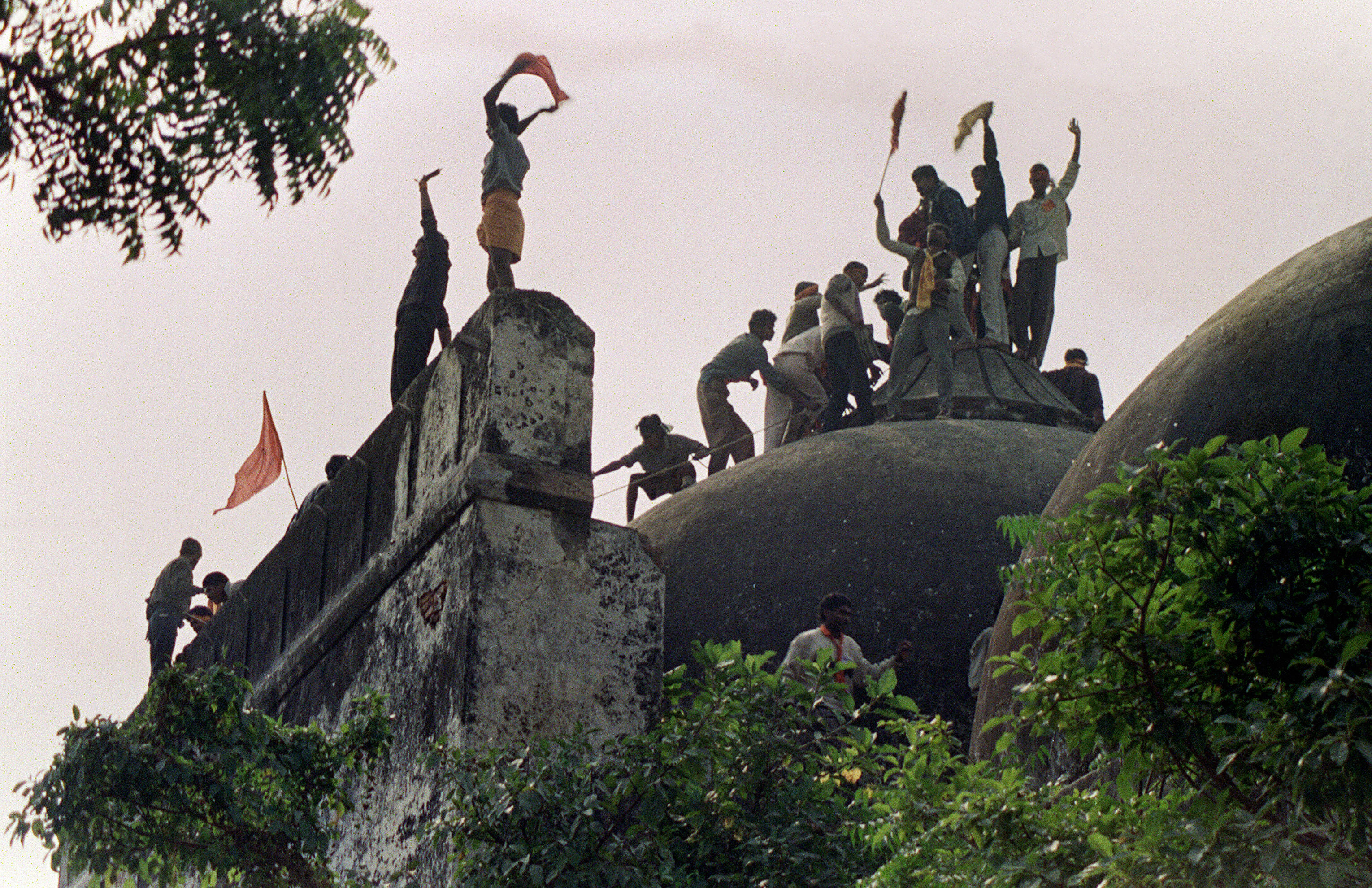 On December 6, 1992 a Hindu mob climbs atop the 16th century Muslim Babri Mosque five hours before the structure was completely demolished by hundreds of Hindu fundamentalist activists.