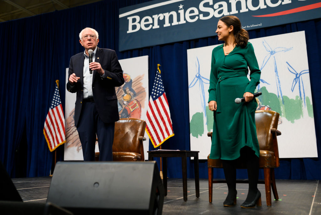 Democratic Presidential candidate Bernie Sanders (I-VT) and U.S. Rep. Alexandria Ocasio-Cortez (D-NY) field questions from audience members at the Climate Crisis Summit at Drake University on November 9, 2019 in Des Moines, Iowa.