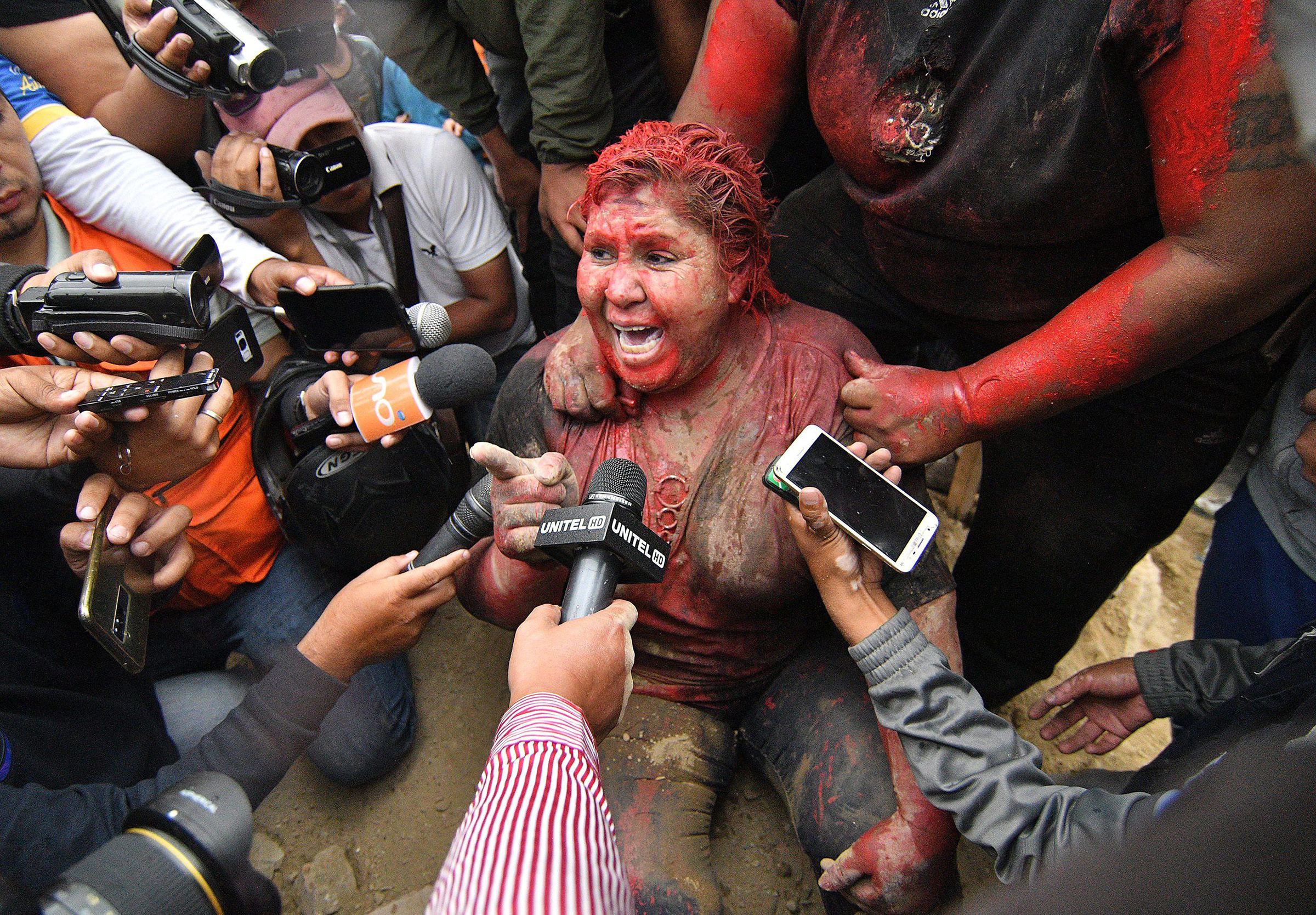 Patricia Arce, mayor of Vinto in Bolivia, speaks to the media after being attacked in the street by a crowd that sprayed her with reddish paint and cut her hair on Nov. 6, 2019.