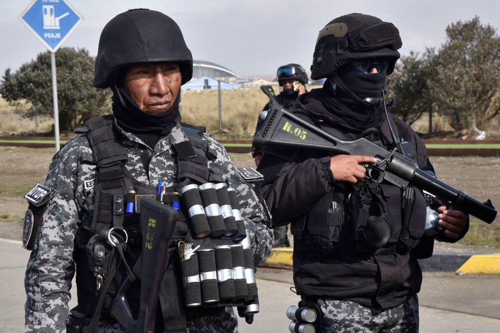 Riot police stand guard outside El Alto International Airport in El Alto, Bolivia, on Nov. 5, 2019.