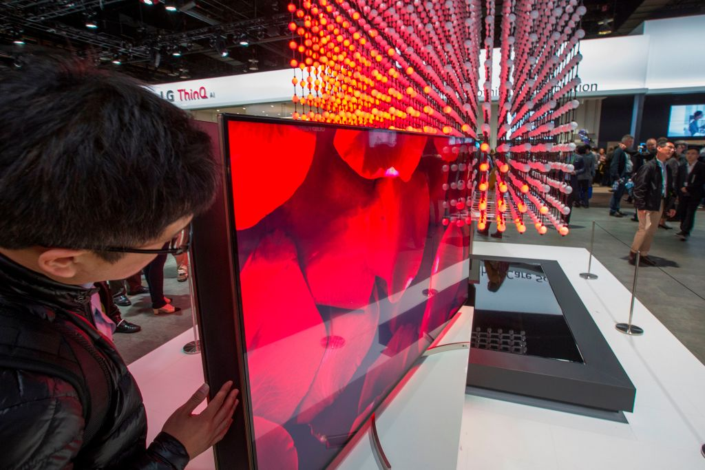 A man looks at an LG Super UHD TV Nano Cell Display at CES in Las Vegas, Nevada, January 9, 2018.   / AFP PHOTO / DAVID MCNEW        (Photo credit should read DAVID MCNEW/AFP via Getty Images)