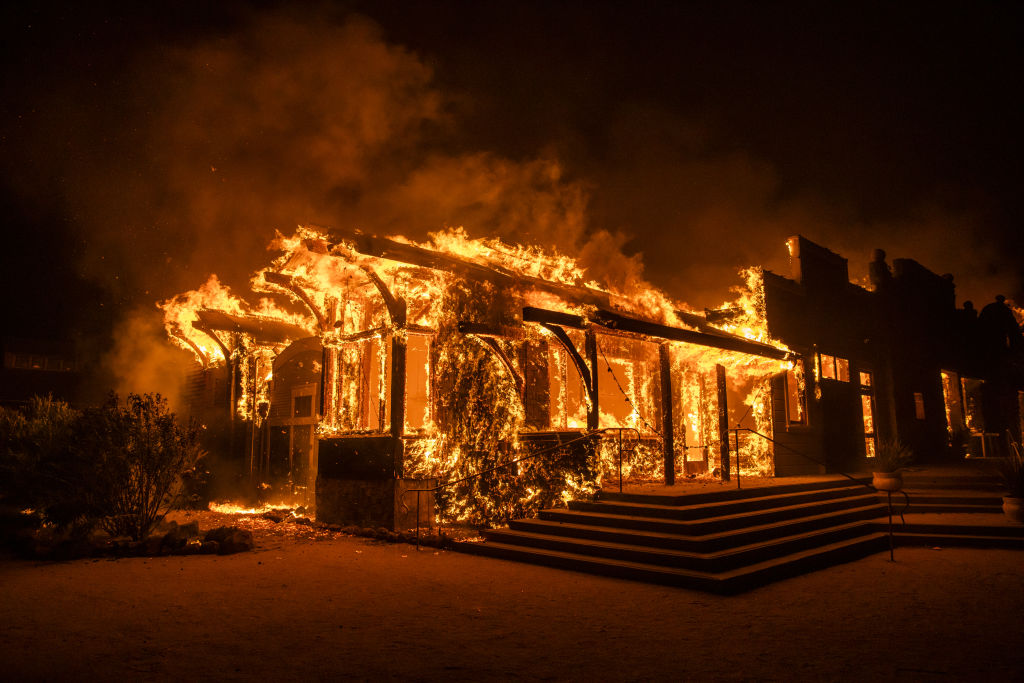 Flames engulf a burning building during the Kincade fire in Healdsburg, California, U.S., on Oct. 27, 2019.