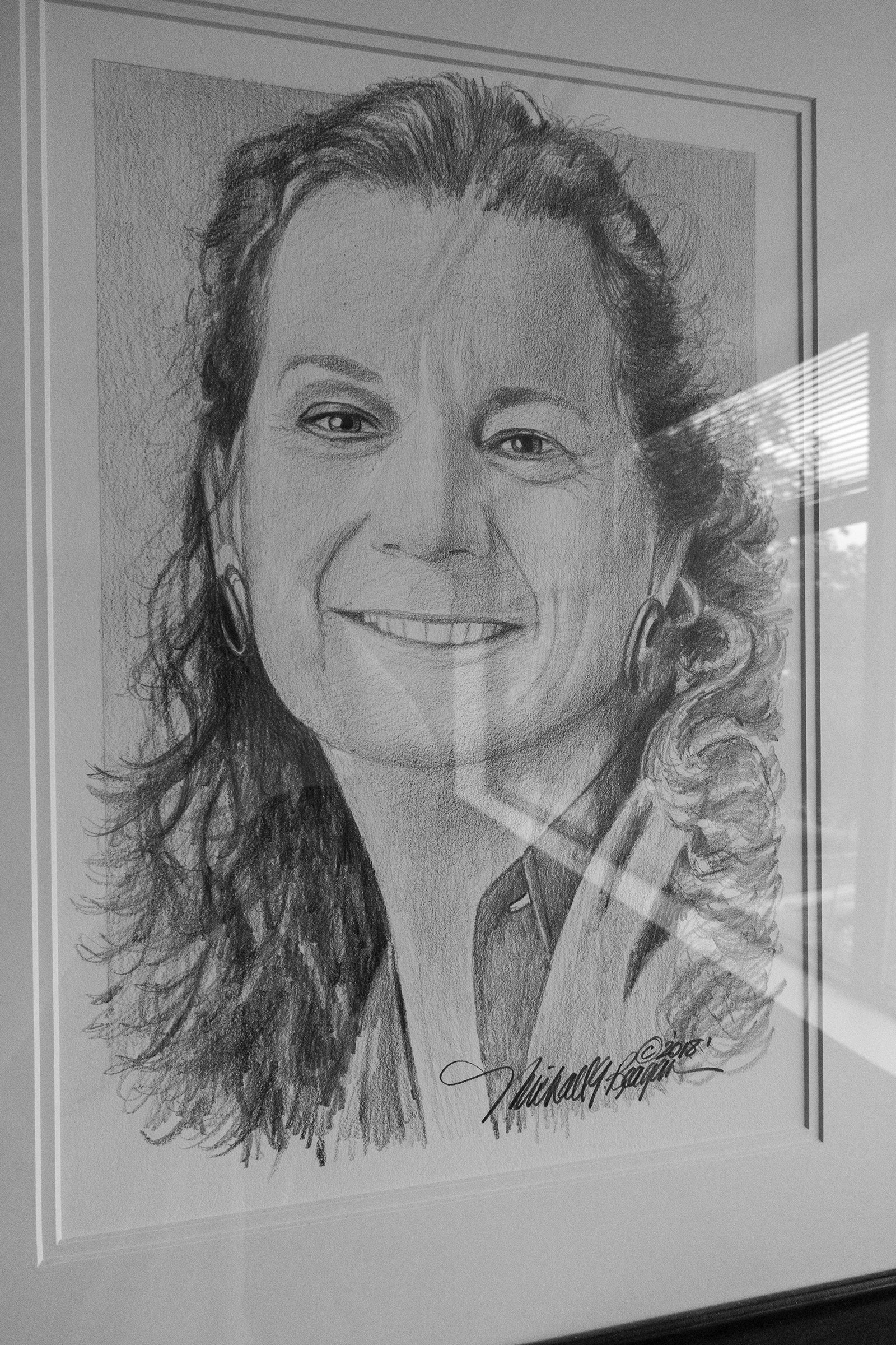 A drawing of shooting victim, Wendi Winters, hangs in the conference room at the new office.