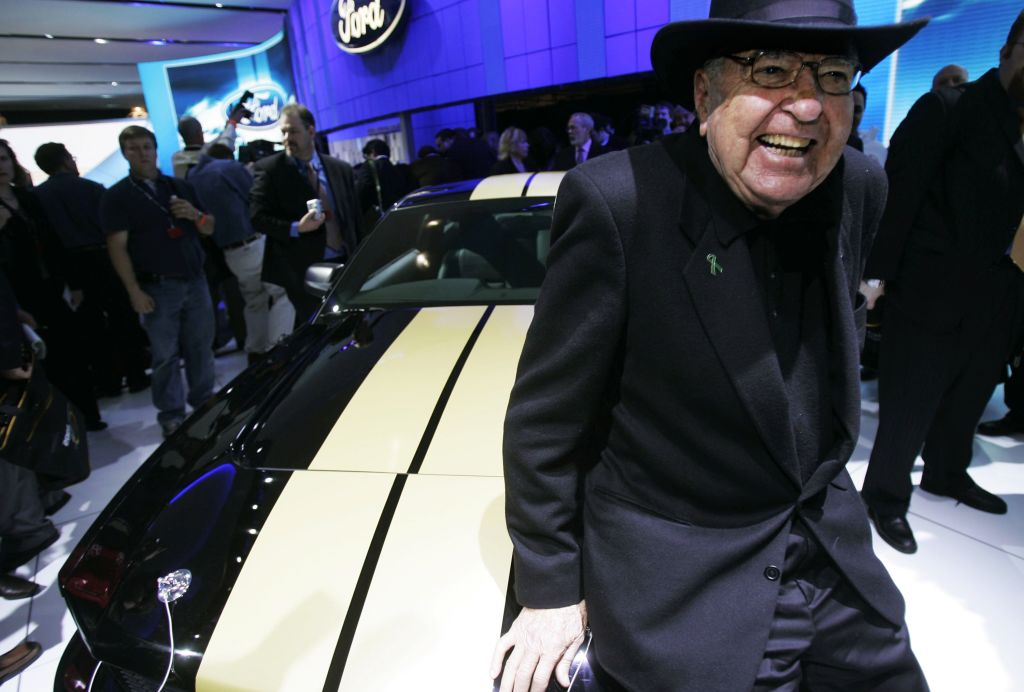 Carroll Shelby poses with the 2007 Ford Shelby Mustang GT-H April 12, 2006 during the press preview of the 2006 New York International Auto Show April 12, 2006 in New York City.