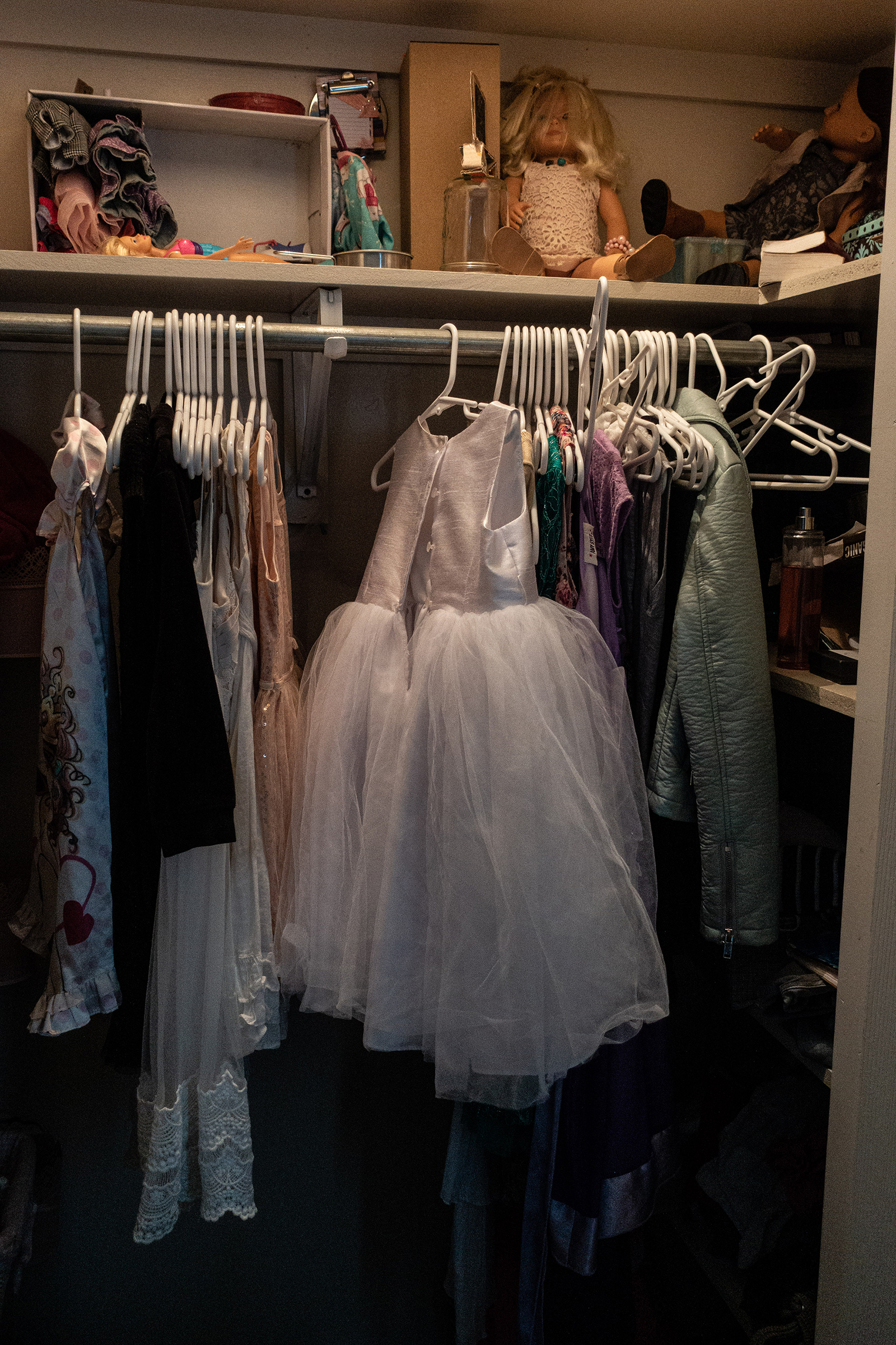 A dress belonging to Krystal Miller hangs in a closet.