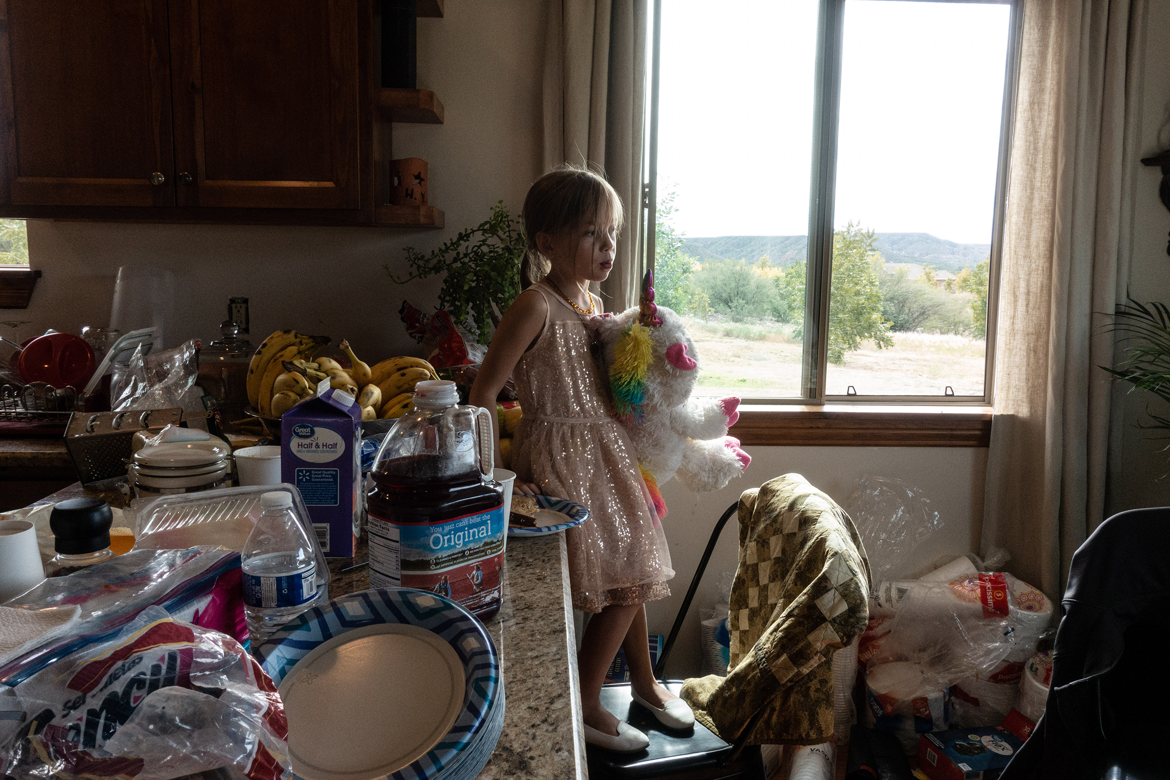 Amaryllis Miller, 5, one of Rhonita Miller's daughters, plays with a stuffed unicorn at the house.