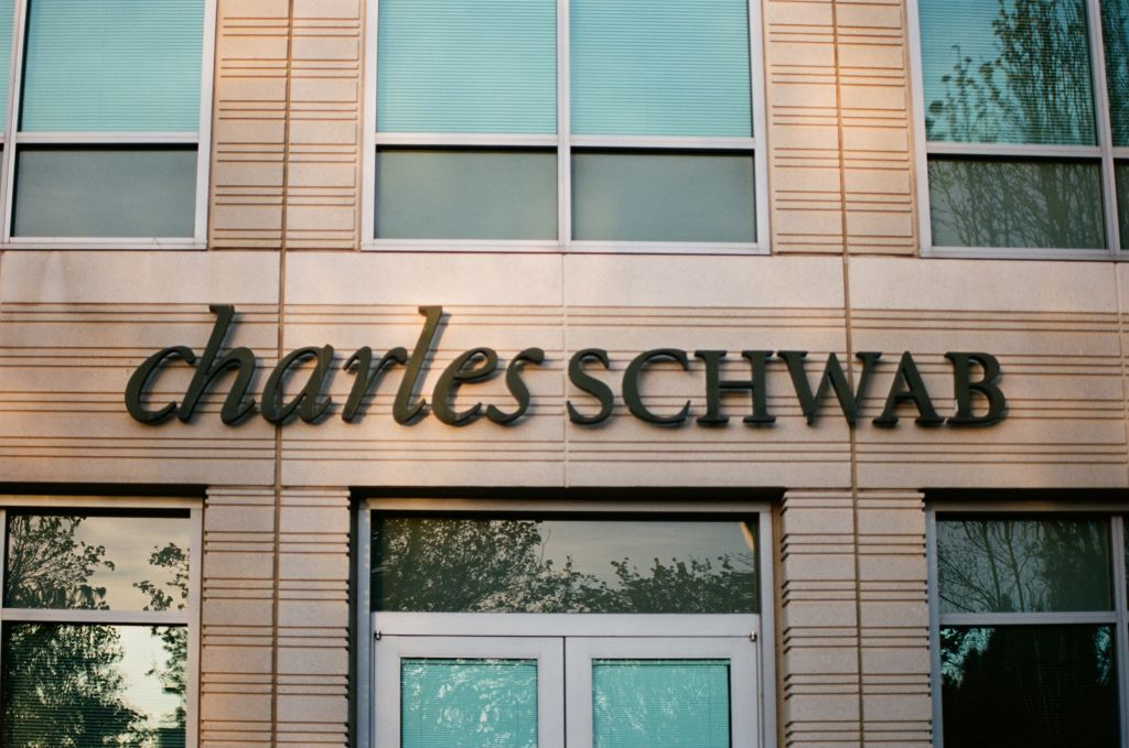 Close-up of sign with logo at Charles Schwab financial adviser branch in Pleasanton, California, March 26, 2018.