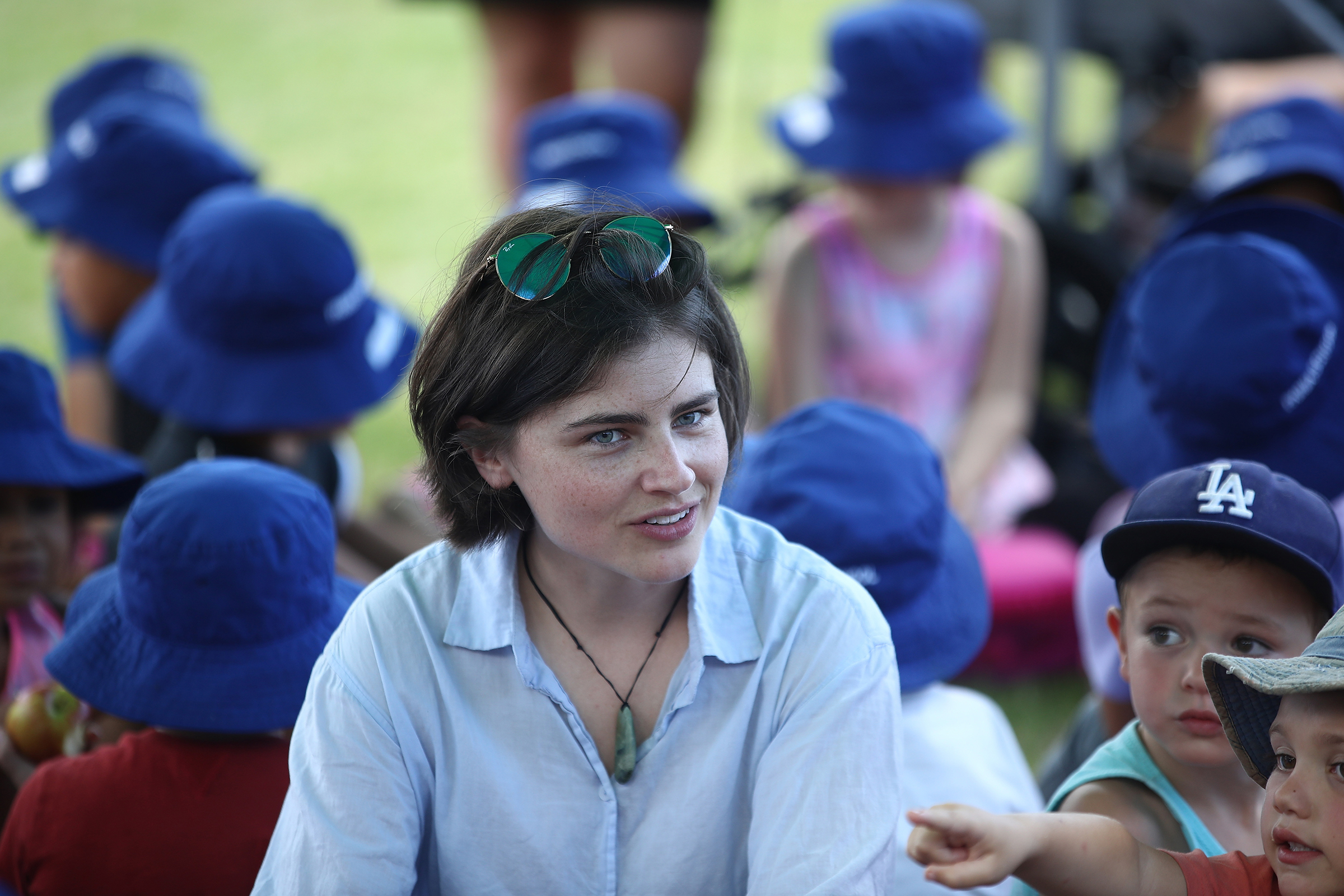 Green Party MP Chloe Swarbrick shares a picnic with children from Paihia Primary School in Waitangi, New Zealand on Feb. 5, 2018.
