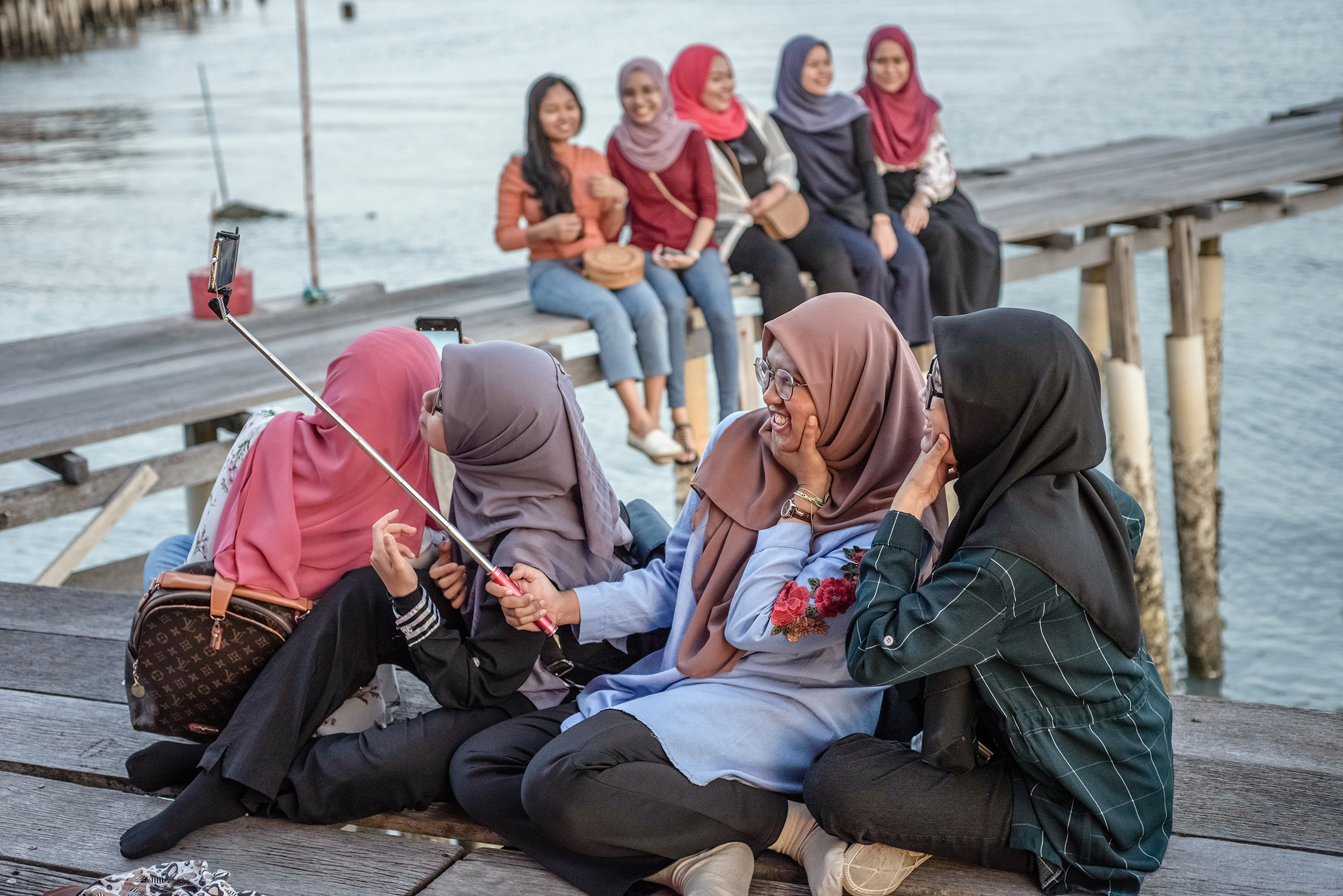 Muslim women enjoy the sunset in one of the Clan Jetties villages, in George Town, Penang Island, Malaysia, in January 2019.