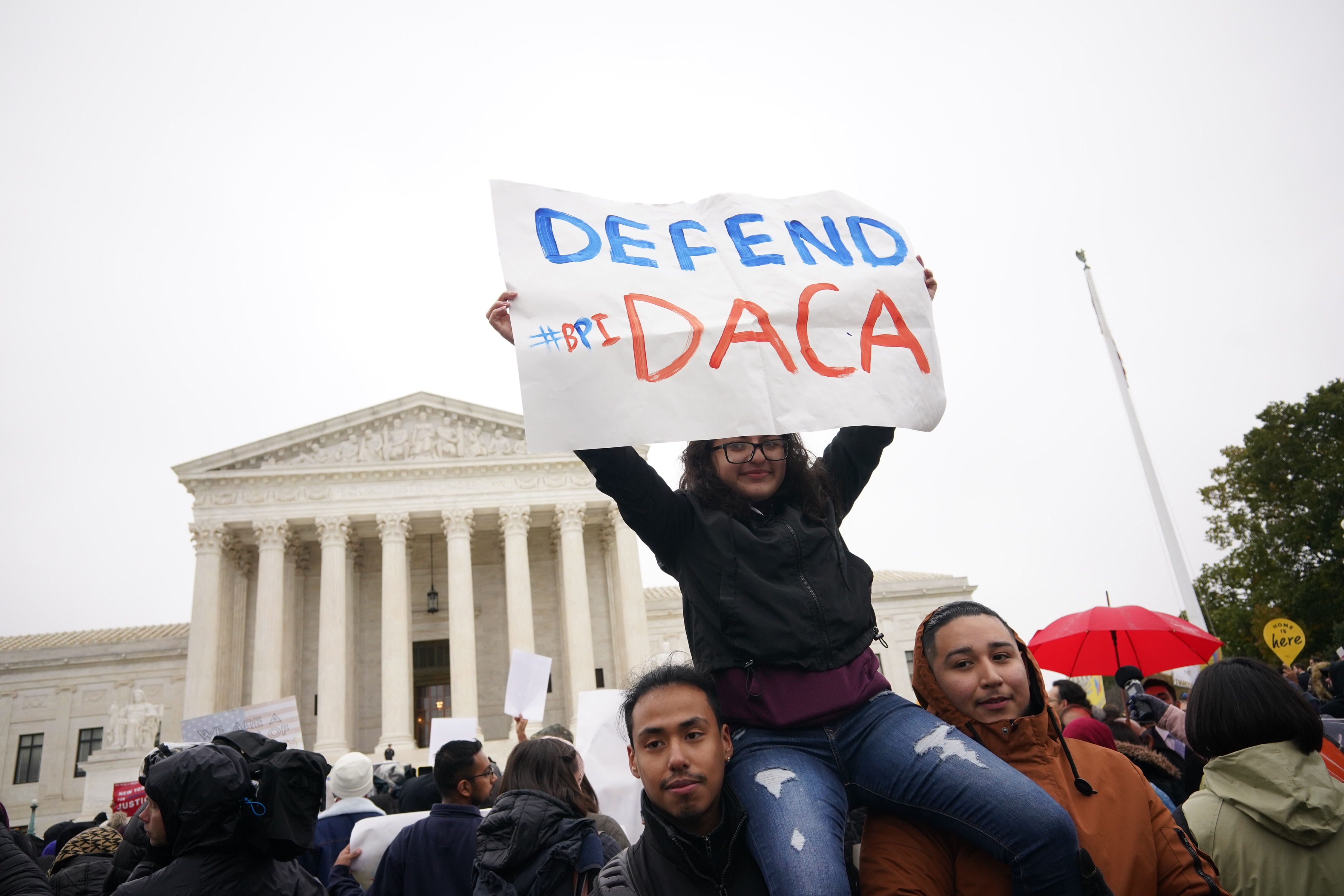 Immigration rights activists take part in a rally in front of the US Supreme Court in Washington, DC on November 12, 2019. - The US Supreme Court hears arguments on November 12, 2019 on the fate of the  Dreamers,  an estimated 700,000 people brought to the country illegally as children but allowed to stay and work under a program created by former president Barack Obama.Known as Deferred Action for Childhood Arrivals or DACA, the program came under attack from President Donald Trump who wants it terminated, and expired last year after the Congress failed to come up with a replacement.