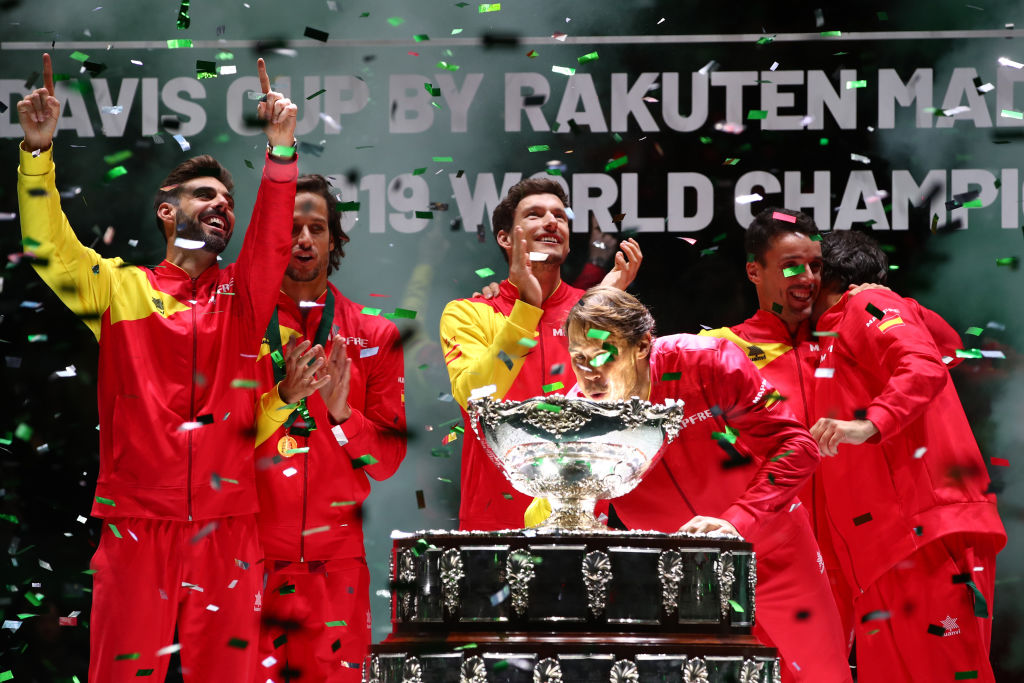 Marcel Granollers, Feliciano Lopez, Pablo Carreno Busta and Roberto Bautista Agut celebrate as Rafael Nadal blows confetti out from the trophy after their 2019 Davis Cup victory at La Caja Magica in Madrid, Spain on Nov. 24, 2019.