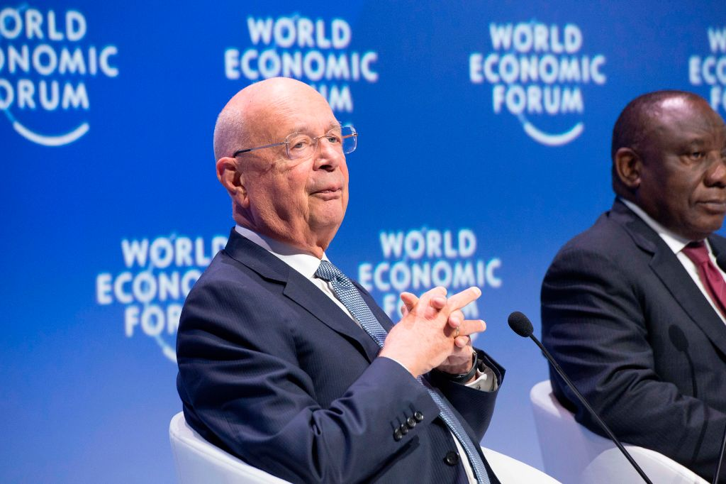 Klaus Schwab, founder of the World Economic Forum sits next to South Africa's President Cyril Ramaphosa, at the plenary session of African Leaders at the World Economic Forum Africa meeting at the Cape Town International Convention Centre, in Cape Town on September 5, 2019.