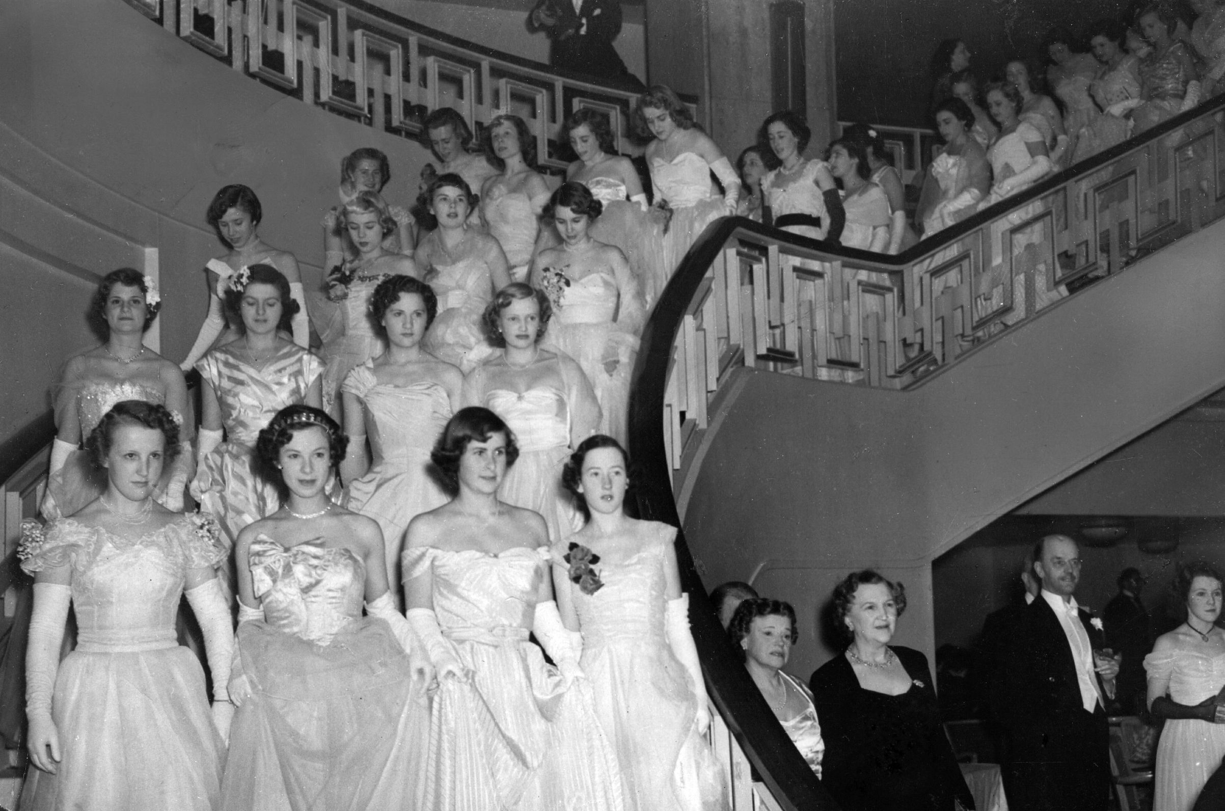 May 19, 1950:  The massed ranks of debutantes at the Queen Charlotte's Ball at Grosvenor House descend into the ballroom.