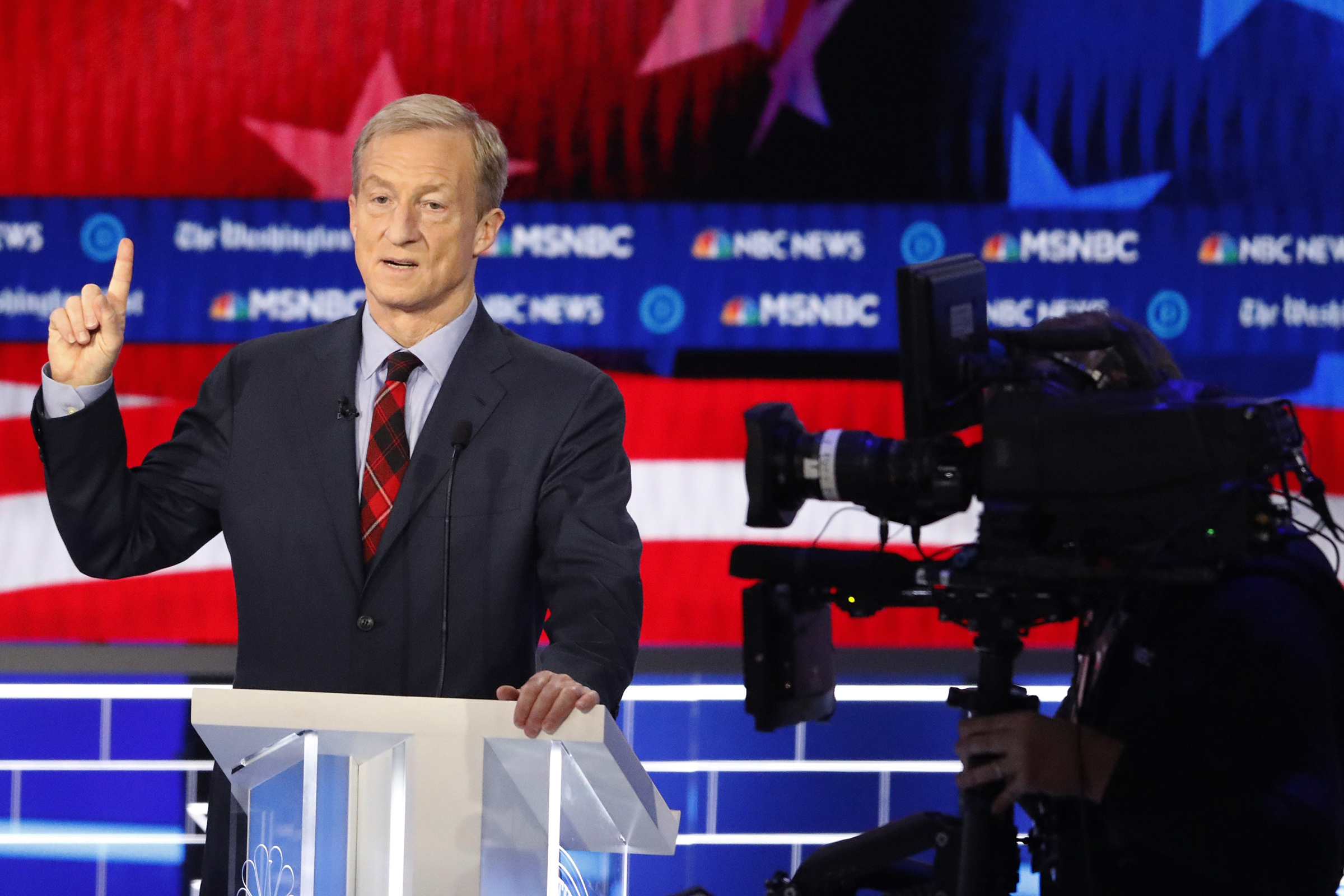 Democratic presidential candidate investor Tom Steyer speaks during a Democratic presidential primary debate in Atlanta on Nov. 20, 2019.