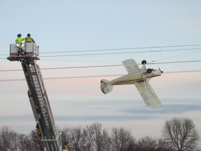 A single-engine Piper Cub propeller plane that became entangled with power lines in Louisville Township, Minnesota on Saturday.