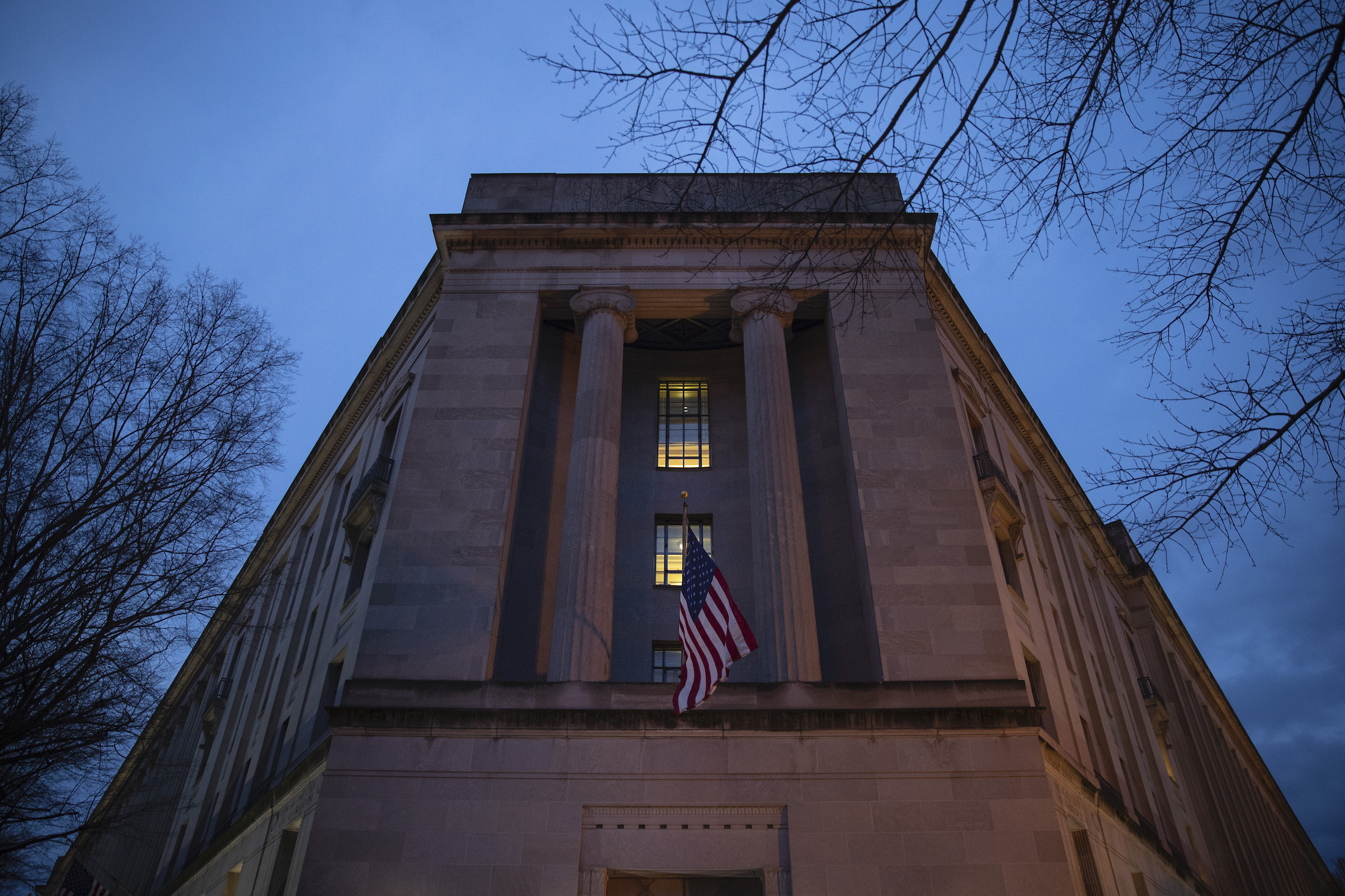 The Department of Justice stands in the early hours of Friday morning, March 22, 2019 in Washington, D.C.
