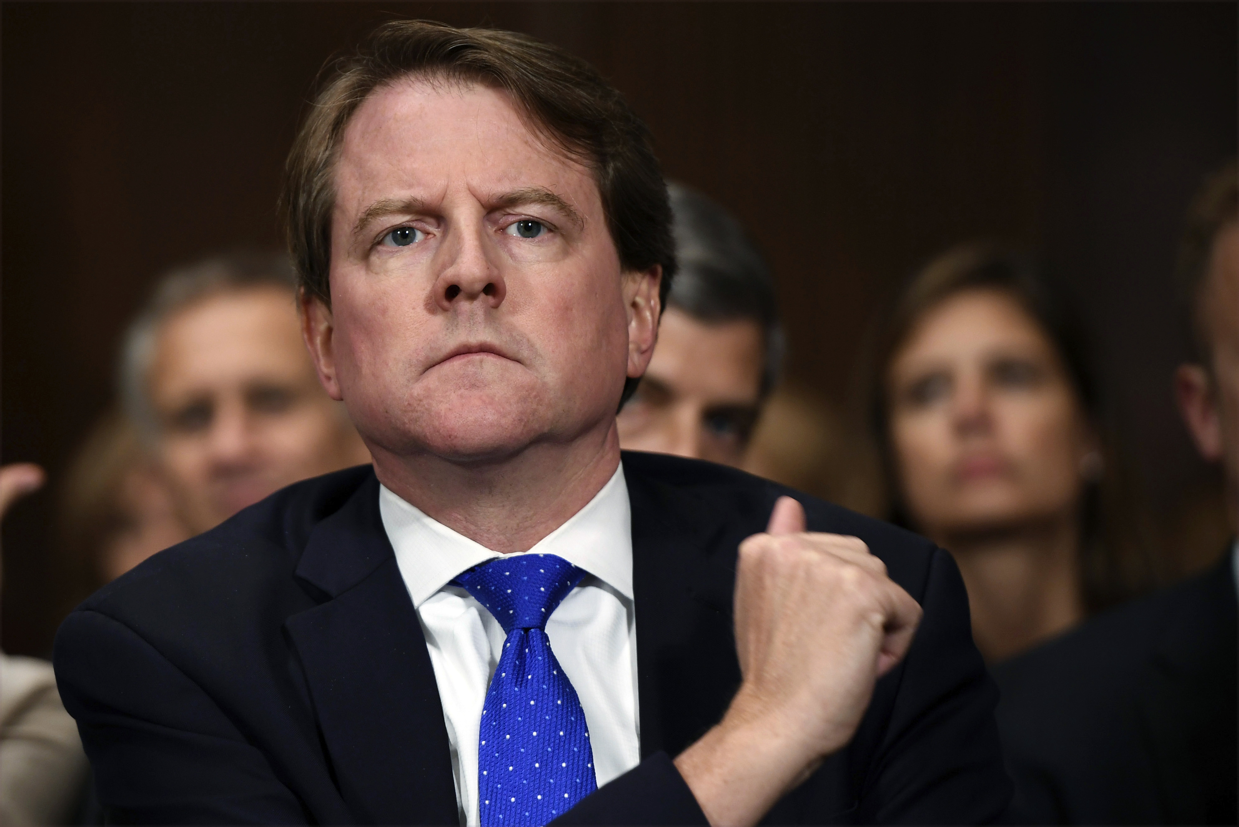 In this Sept. 27, 2018, file photo, then-White House counsel Don McGahn listens as Supreme court nominee Brett Kavanaugh testifies before the Senate Judiciary Committee on Capitol Hill in Washington.