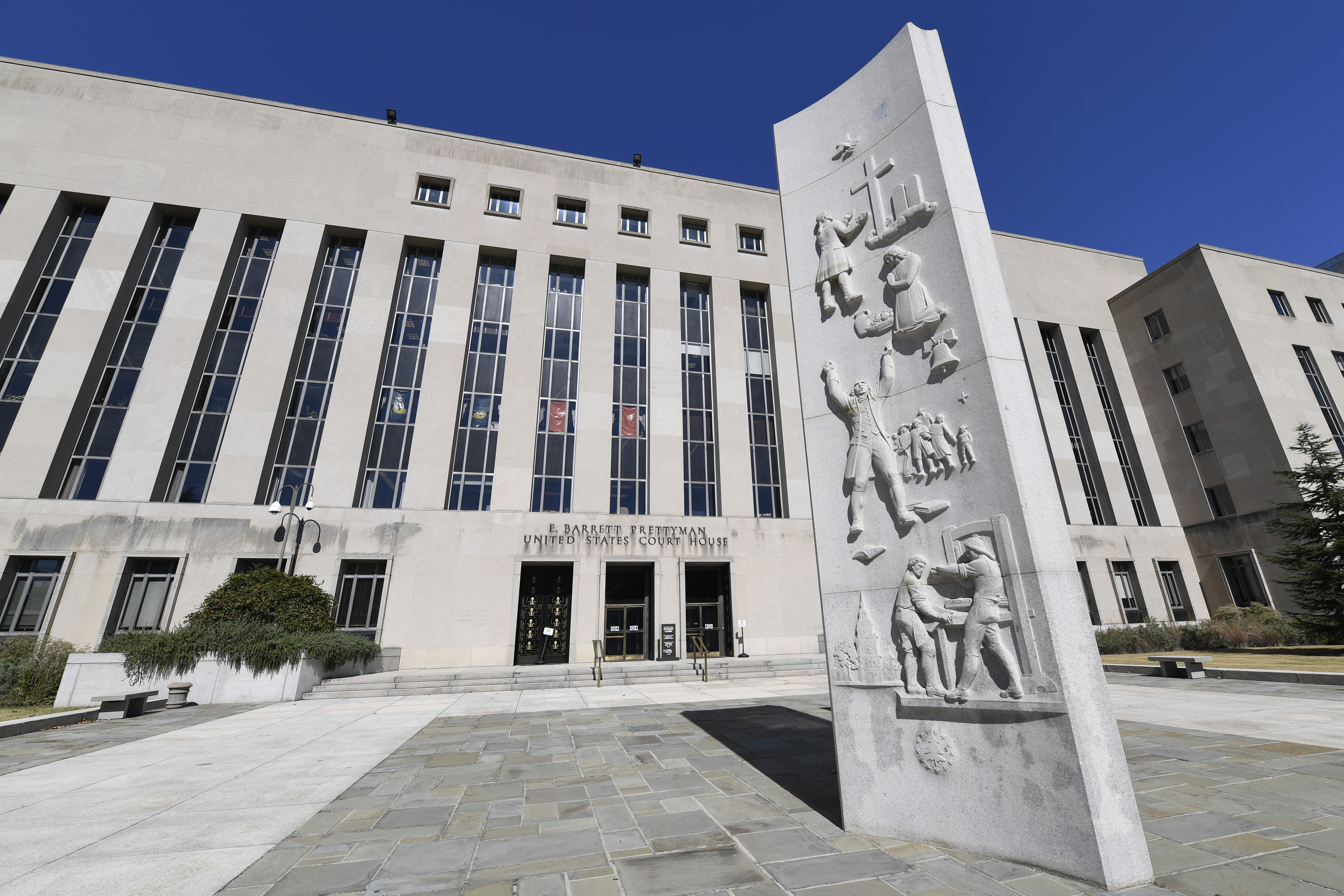In this Oct. 11, 2019 file photo, a view of the E. Barrett Prettyman United States Courthouse in Washington.  A federal judge in the District of Columbia has temporarily halted the first federal execution in 16 years as a lawsuit on how the government intends to carry it out continues.