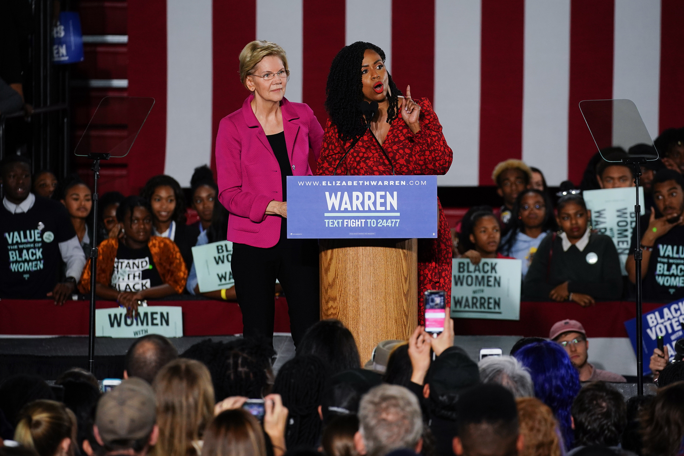 Democratic presidential candidate Sen. Elizabeth Warren (D-MA), stands with U.S. Rep. Ayanna Pressley (D-MA) as she addresses a group of protesters during a campaign event at Clark Atlanta University on Nov. 21, 2019.