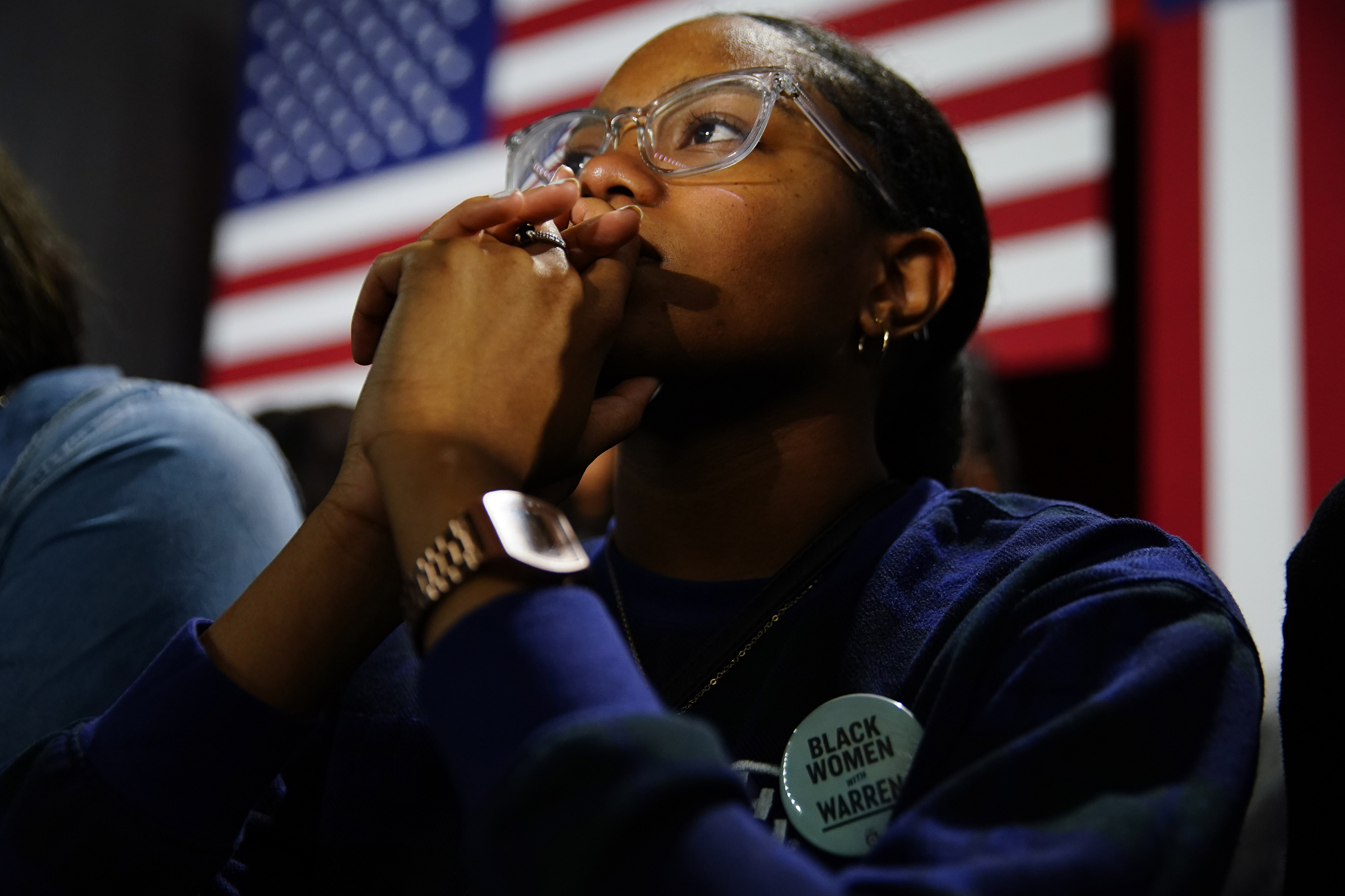 An attendee wears a button supporting Sen. Elizabeth Warren (D-MA), at a campaign event at Clark Atlanta University on Nov. 21, 2019.