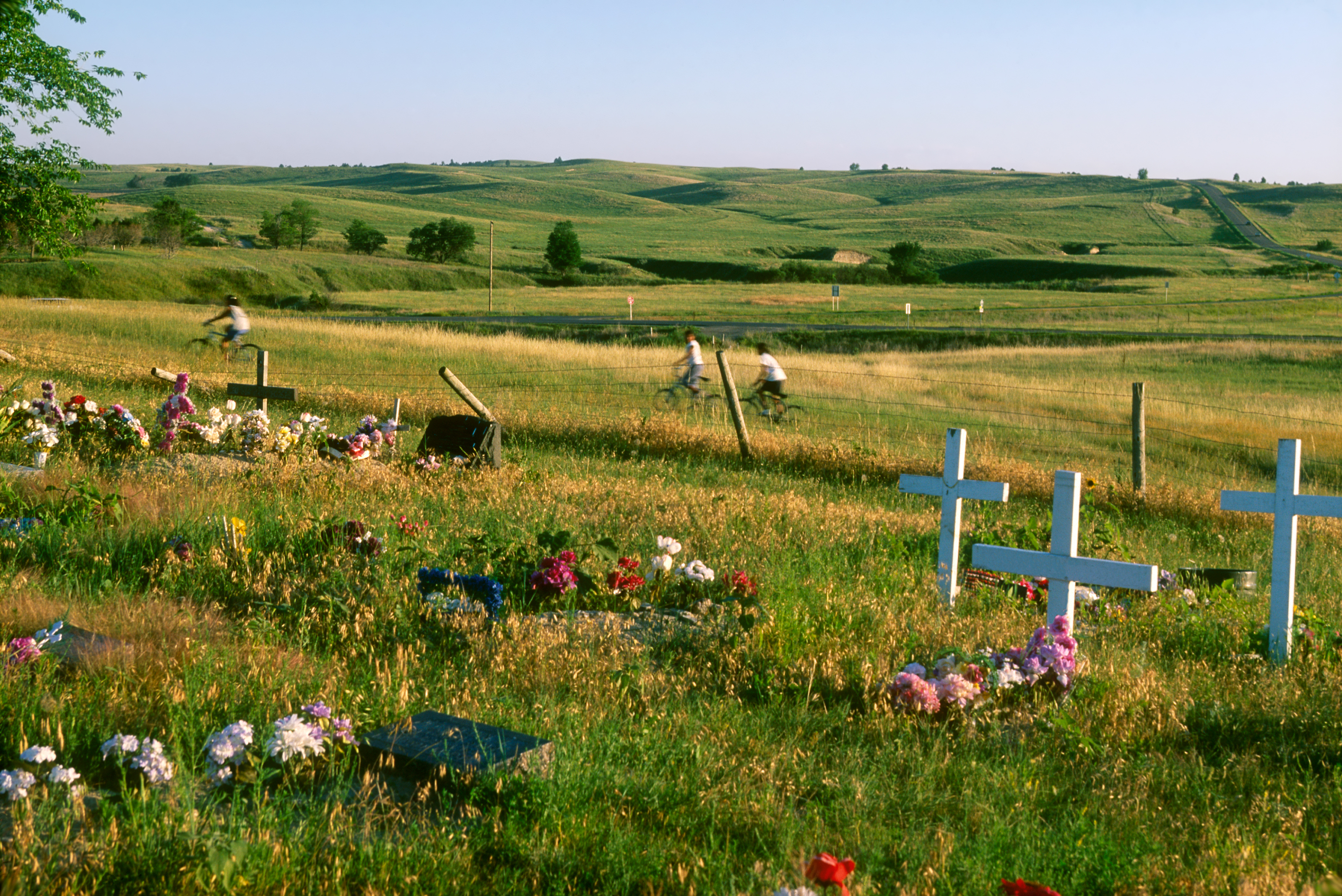 Native American children playing around the cemetery of Wounded Knee, site of the Dec. 29, 1890 historic massacre of a Sioux tribe in South Dakota.