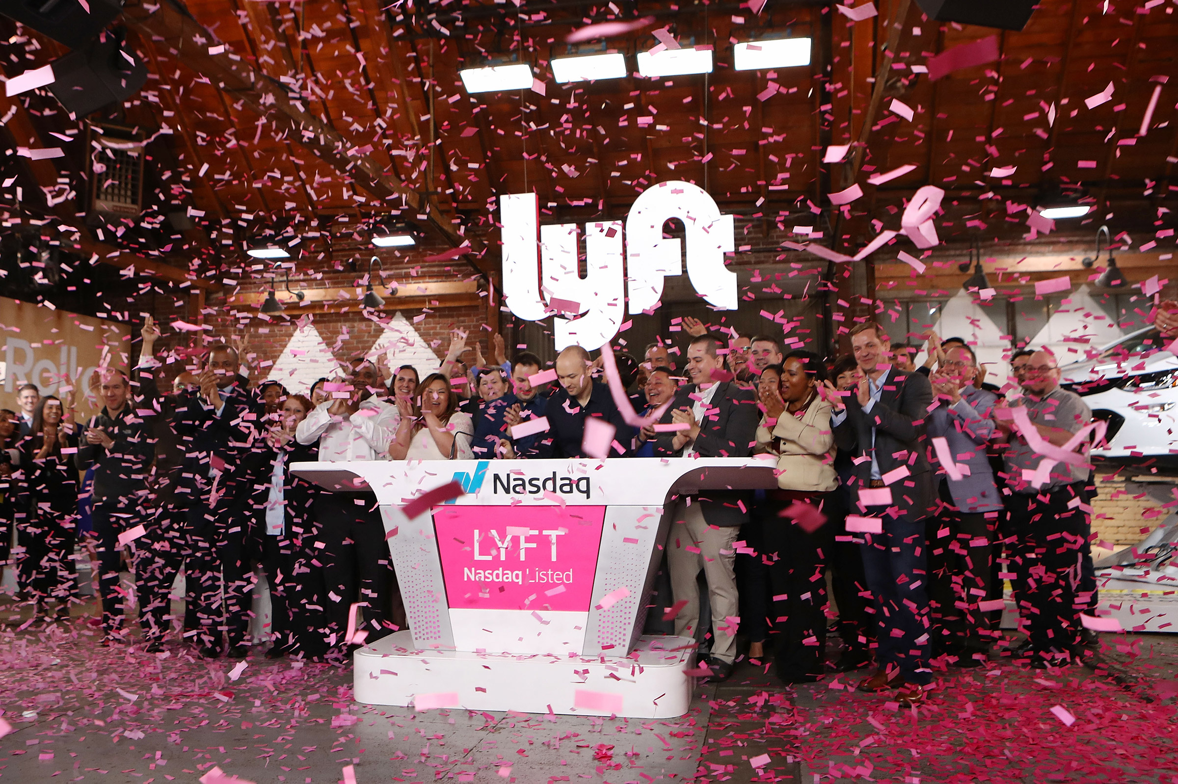Confetti falls as Lyft CEO Logan Green rings the Nasdaq opening bell celebrating the company's initial public offering on March 29, 2019 in Los Angeles.