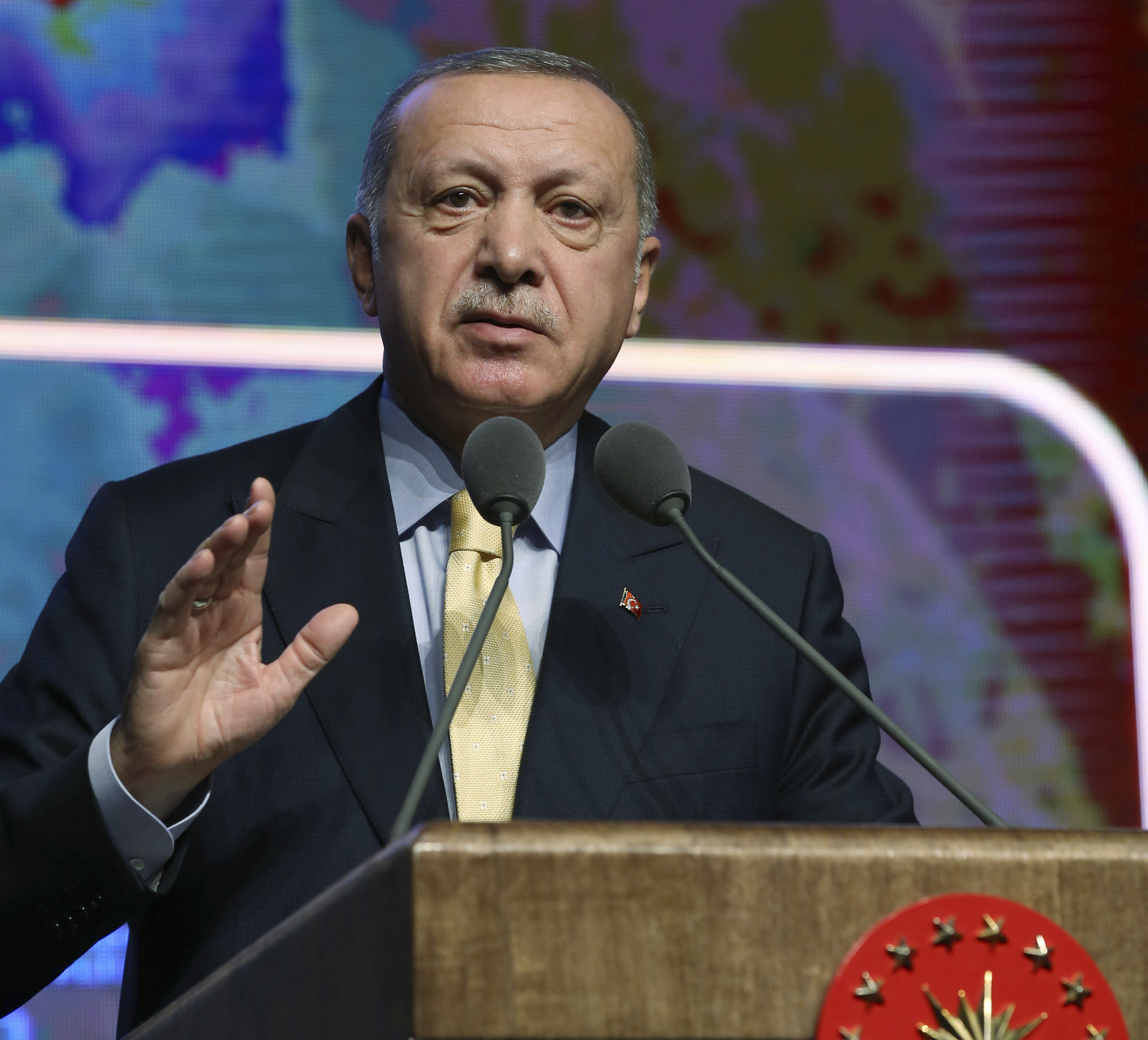 Turkish President Recep Tayyip Erdogan speaks during a meeting in Ankara, Turkey, Wednesday, Nov. 6, 2019. Erdogan says Turkey has captured a wife of the slain leader of the Islamic State group, Abu Bakr al-Baghdadi. Erdogan made the announcement while delivering a speech in Ankara on Wednesday but gave no other details.